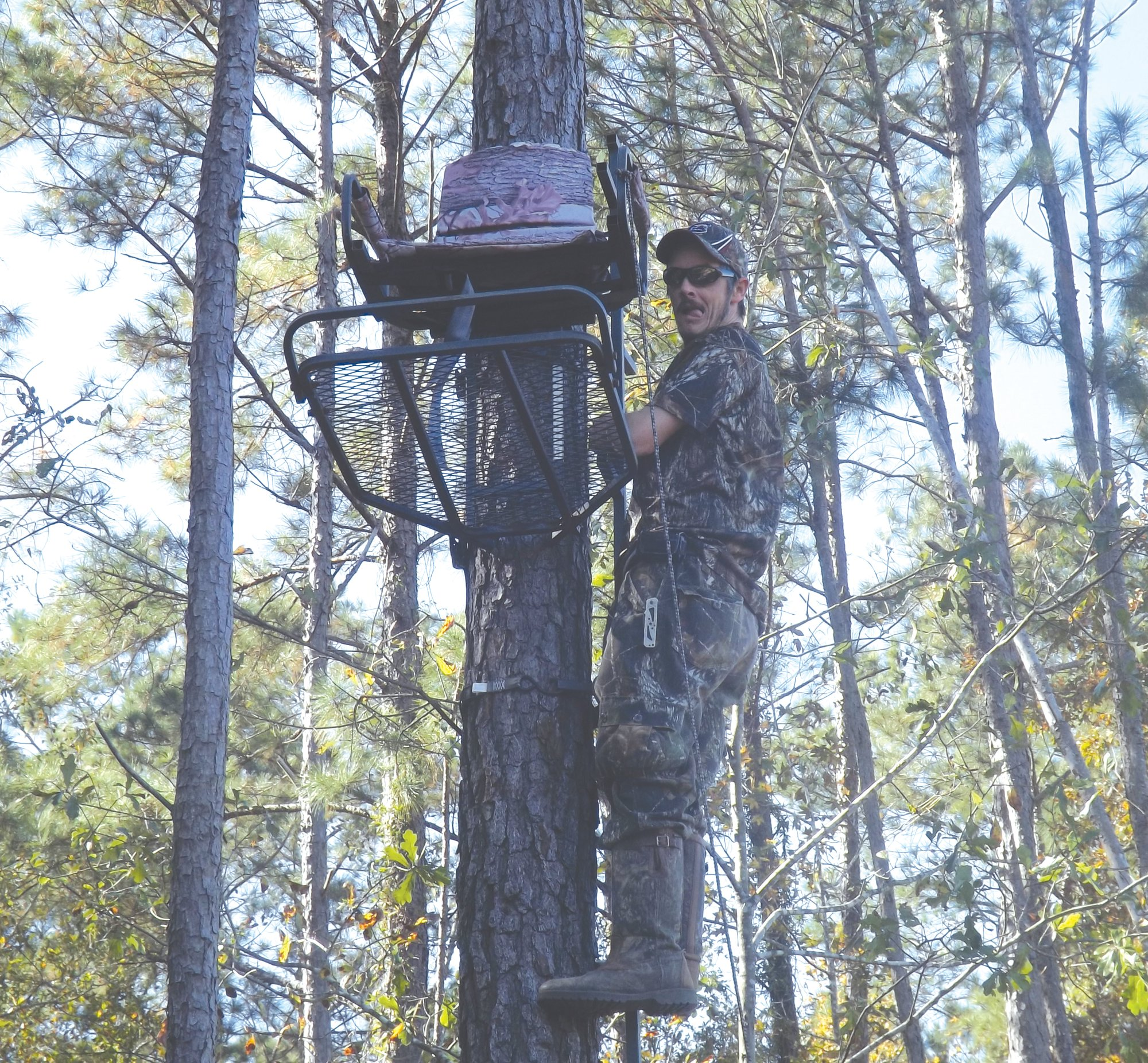 Clayton Geddings checks out a deer stand before the season starts.