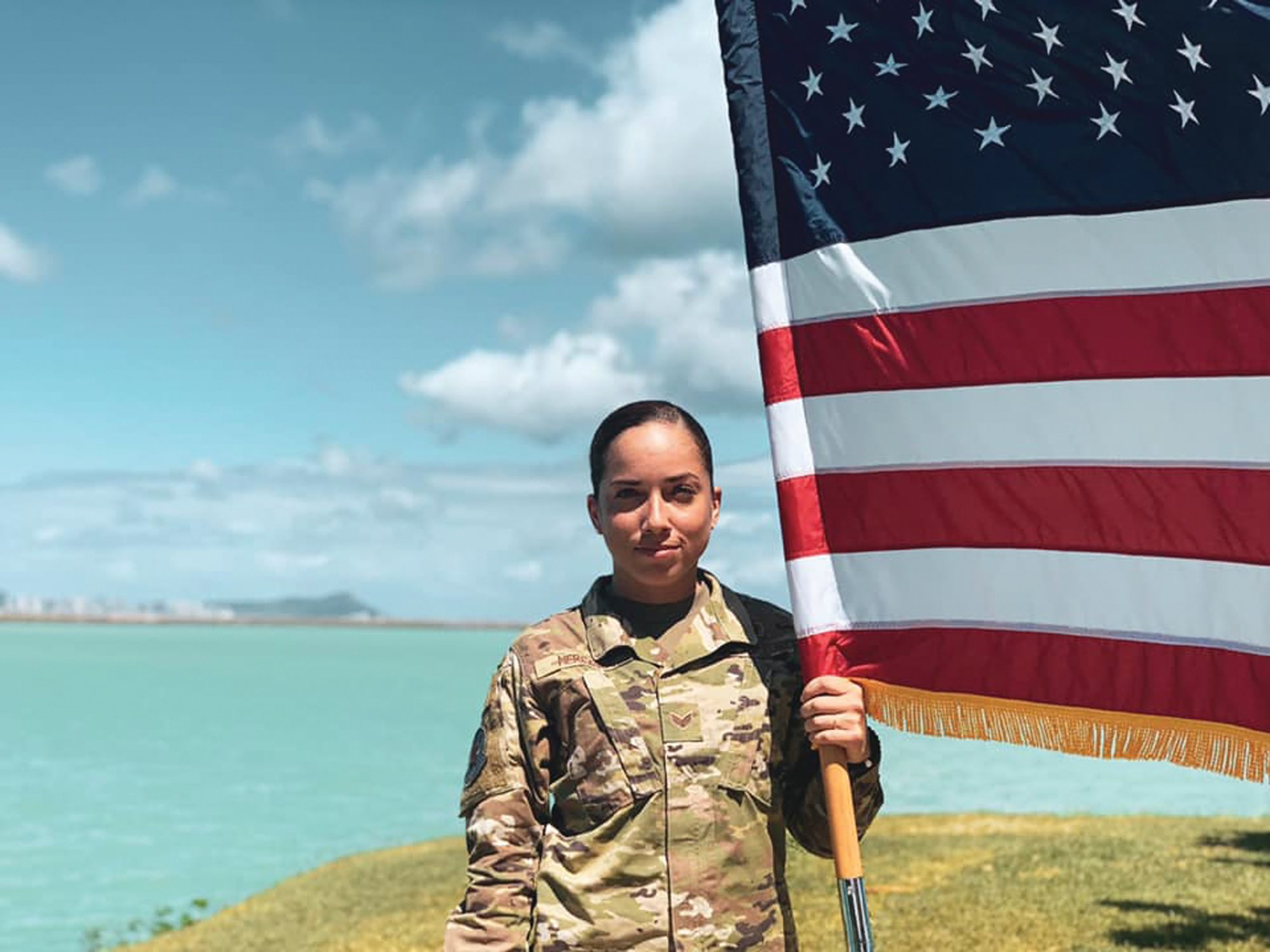 In this June 2019 photo, U.S. Air Force Senior Airman Xiara Mercado stands at Pearl Harbor, Hawaii. A Facebook post by Mercado, of Puerto Rico, drew wide attention when she described a recent encounter at a Honolulu Starbucks with a woman who complained about her talking in Spanish on the phone. Mercado wouldn't comment on recent anti-Latino violence that has terrified many Hispanics but insisted people should speak up when they suffer discrimination.