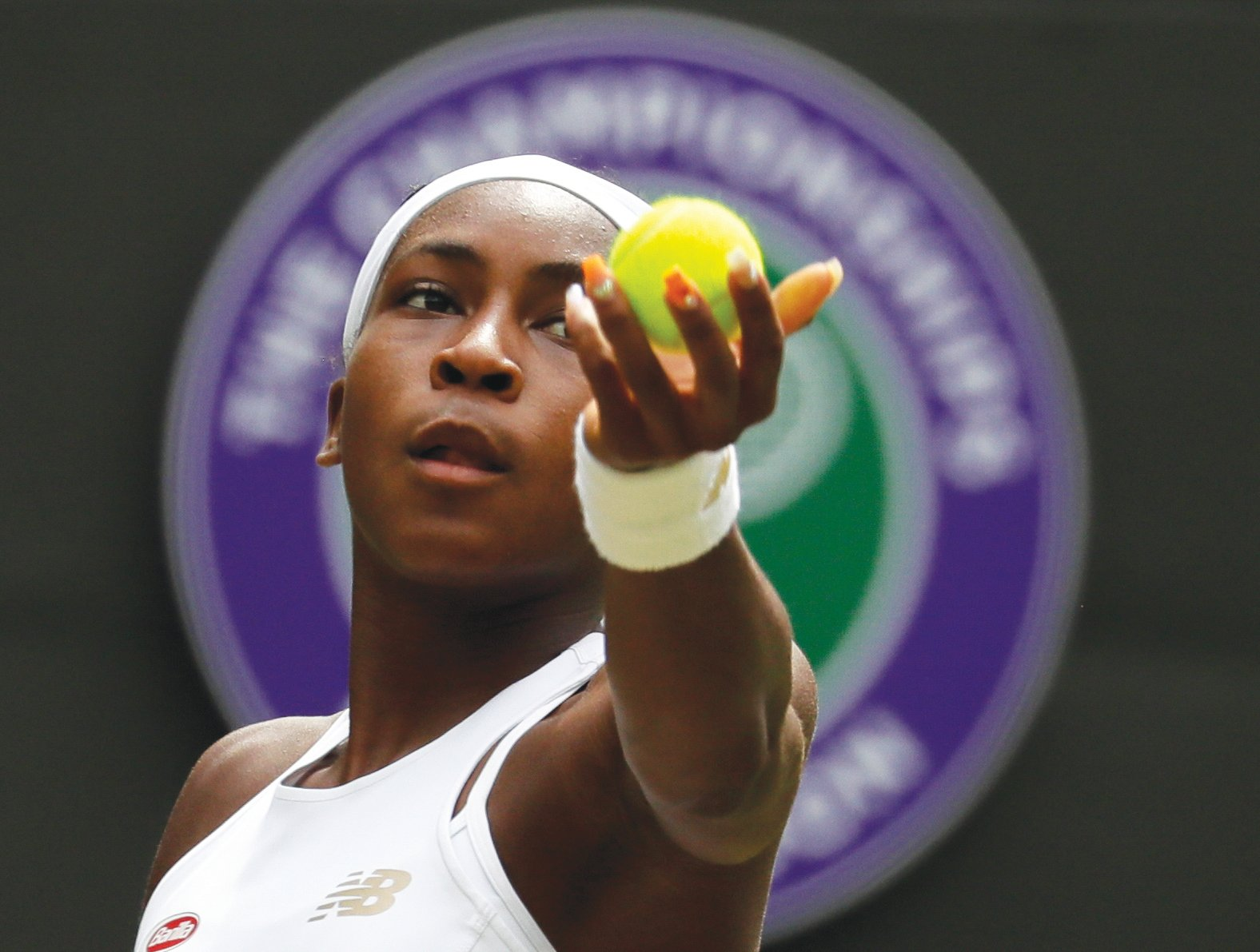 "United States' Cori ""Coco"" Gauff serves to Romania's Simona Halep in a women's singles match during day seven of the Wimbledon Tennis Championships in London on Monday."
