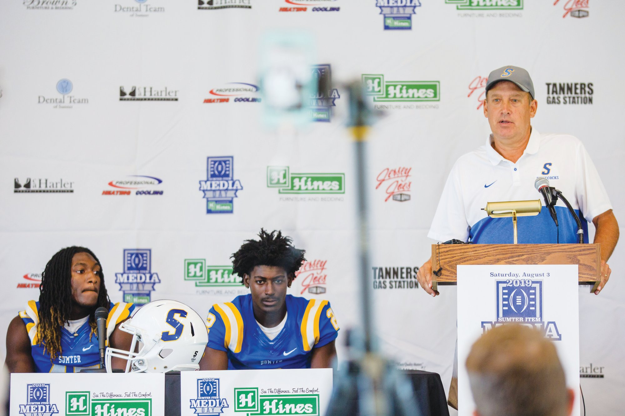 Micah Green / The Sumter Item  Sumter High football head coach Mark Barnes, right, answers a question during The Sumter Item Media Day while players Kirkland Boone, left, and O'Donnell Fortune listen. The Gamecocks will be facing 3-time defending 5A state champion Dutch Fork in the a scrimmage in the 38th Annual Sumter Sertoma Football Jamboree on Friday at Memorial Stadium.