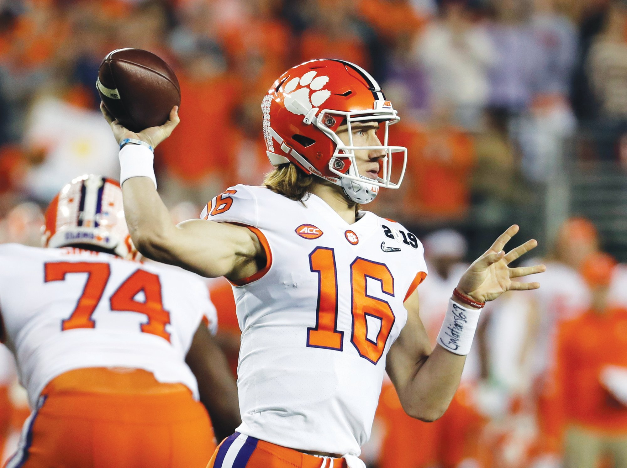 THE ASSOCIATED PRESSTrevor Lawrence is back at quarterback for his sophomore season after leading the Tigers to the national title as a freshman.