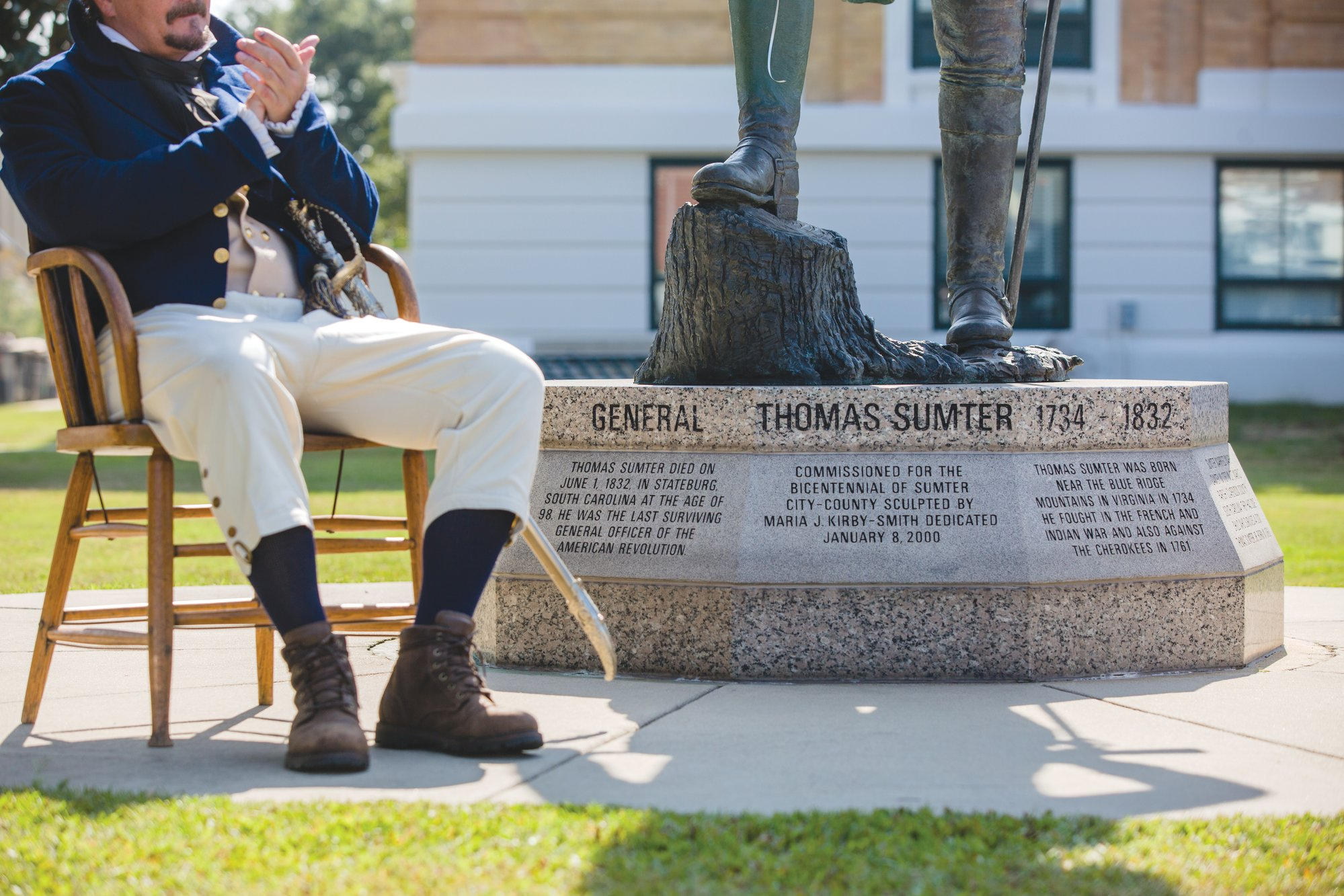 Sumter County Communications Coordinator Joe Perry, portraying Gen. Thomas Sumter, is seen next to the city's statue of the Revolutionary War soldier and Congressman during a celebration of Sumter's birthday on Wednesday. Community members, some in period dress, gathered to celebrate the man who is our city's namesake.