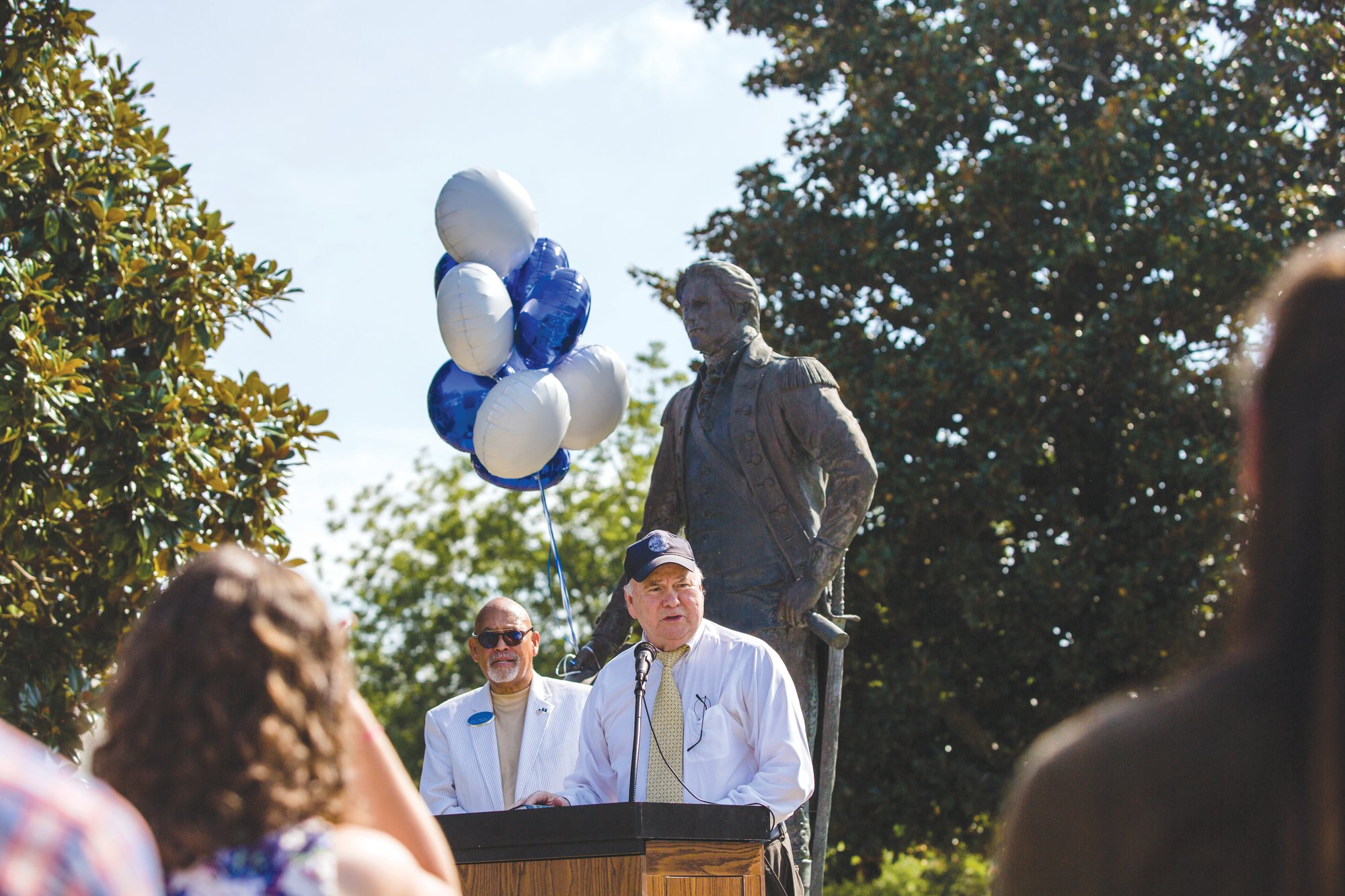 Sumter Item archivist and historian Sammy Way speaks about Sumter's namesake, Gen. Thomas Sumter, during a 285th birthday celebration for the Revolutionary War soldier on Wednesday at the Sumter County Courthouse. Jim McCain, chairman of Sumter County Council, looks on in front of a statue of Sumter.