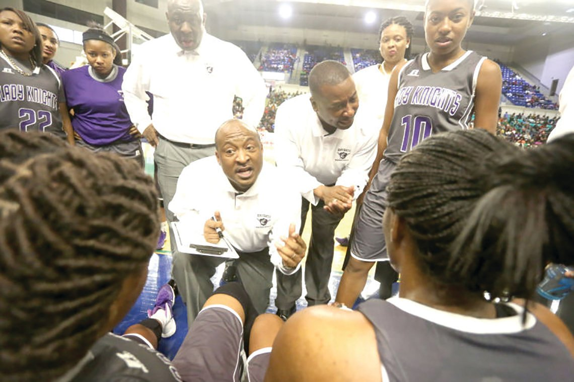SUMTER ITEM FILE PHOTO Tony Wilson, kneeling, will be the head coach of Crestwood High School girls basketball program after two years serving as the boys head coach. Wilson was the girls coach for 11 years before taking on the boys. Former Hartsville High head coach Aric Samuel is the new boys head coach.