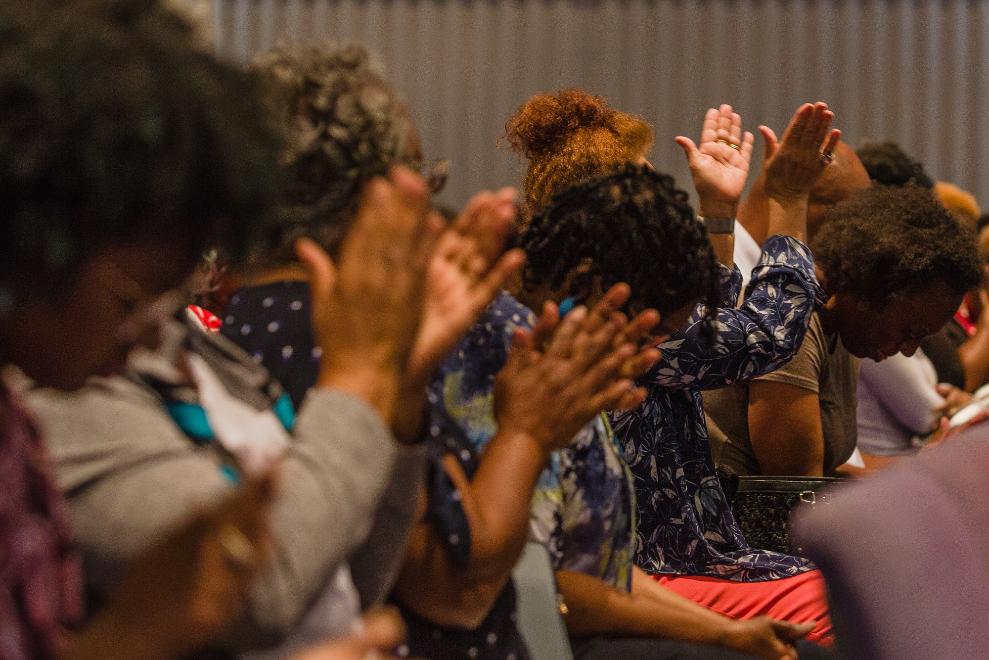 Members of Trinity Missionary Baptist Church pray for Nevaeh on Wednesday.