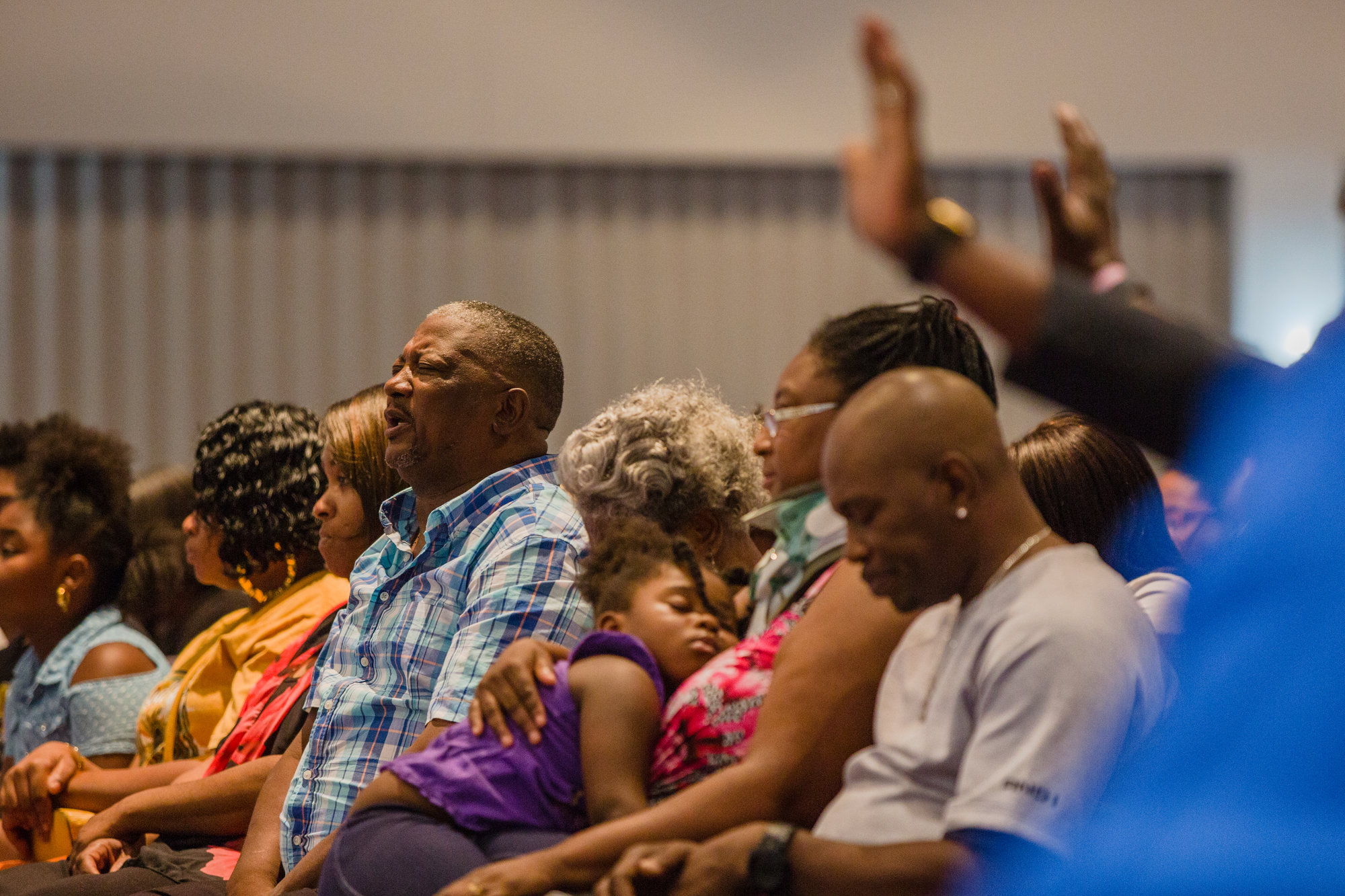 Family and friends pray at Trinity Missionary Baptist Church for 5-year-old Nevaeh Adams on Wednesday.