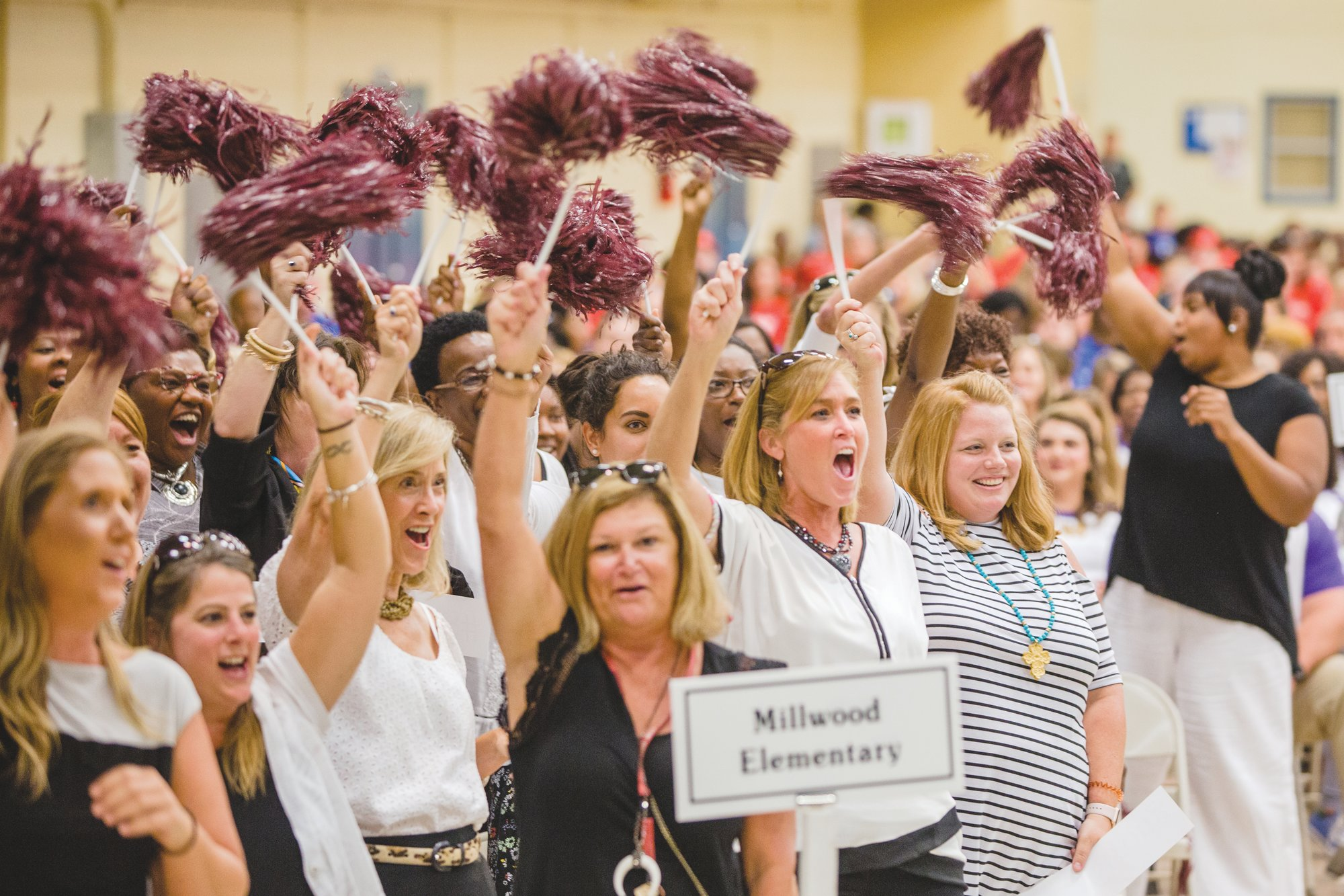 Millwood Elementary celebrates when the school's name is called during the annual Sumter School District opening meeting at Sumter County Civic Center on Friday afternoon.