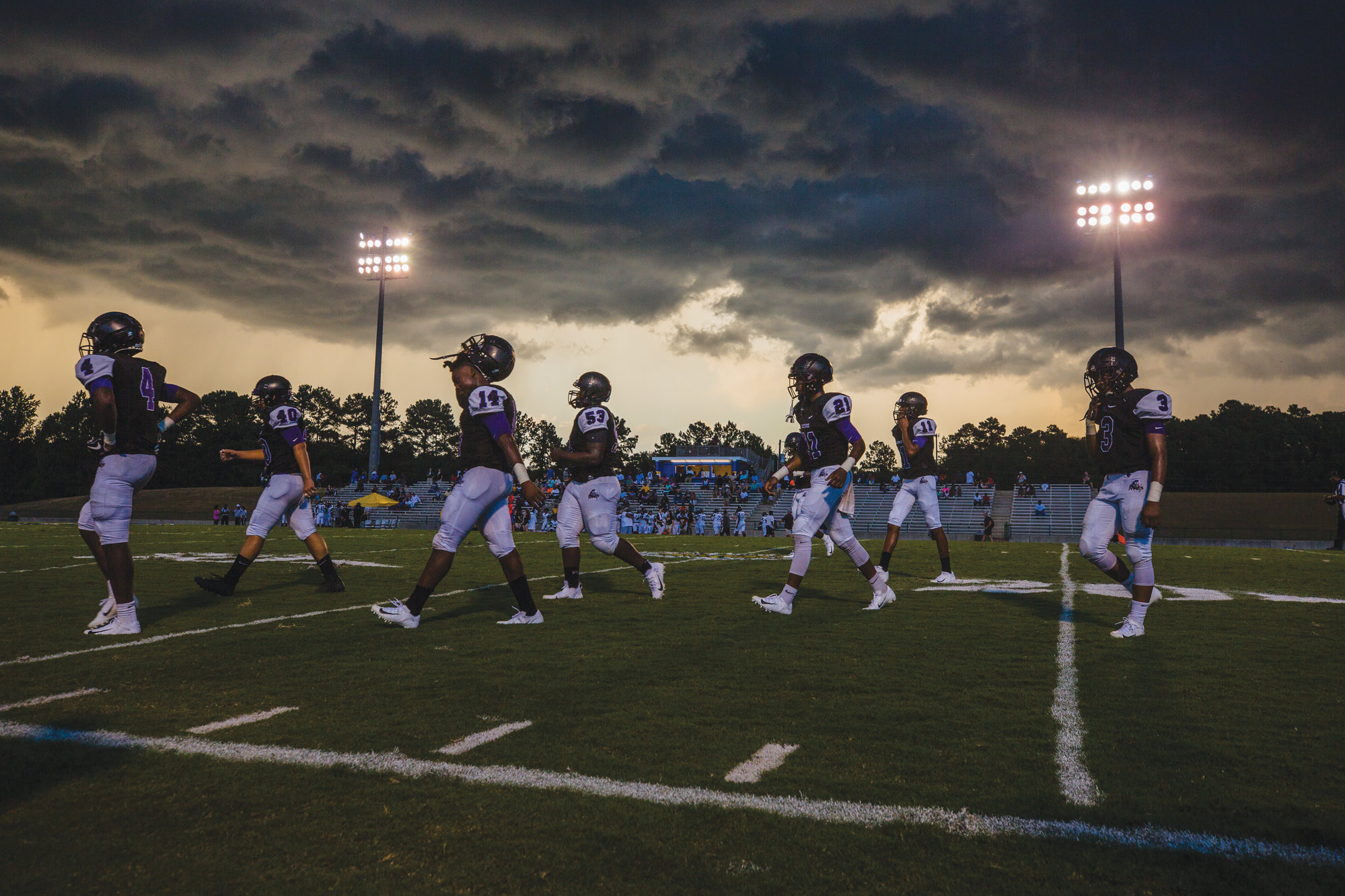 Photo by Micah Green/The Sumter ItemThe Crestwood football team leaves the field as a weather delay forces the end of the Sumter County Jamboree on Friday.