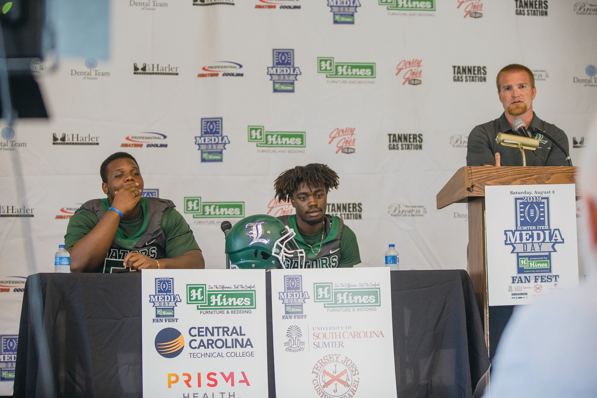 Micah Green / The Sumter ItemLakewood head coach Larry Cornelius speaks while two of his players, Kyliek Baxter, left, and Justin Anderson listen during The Sumter Item Media Day Fan Fest earlier this month. The Gators open their season on Friday at home against Colleton County.