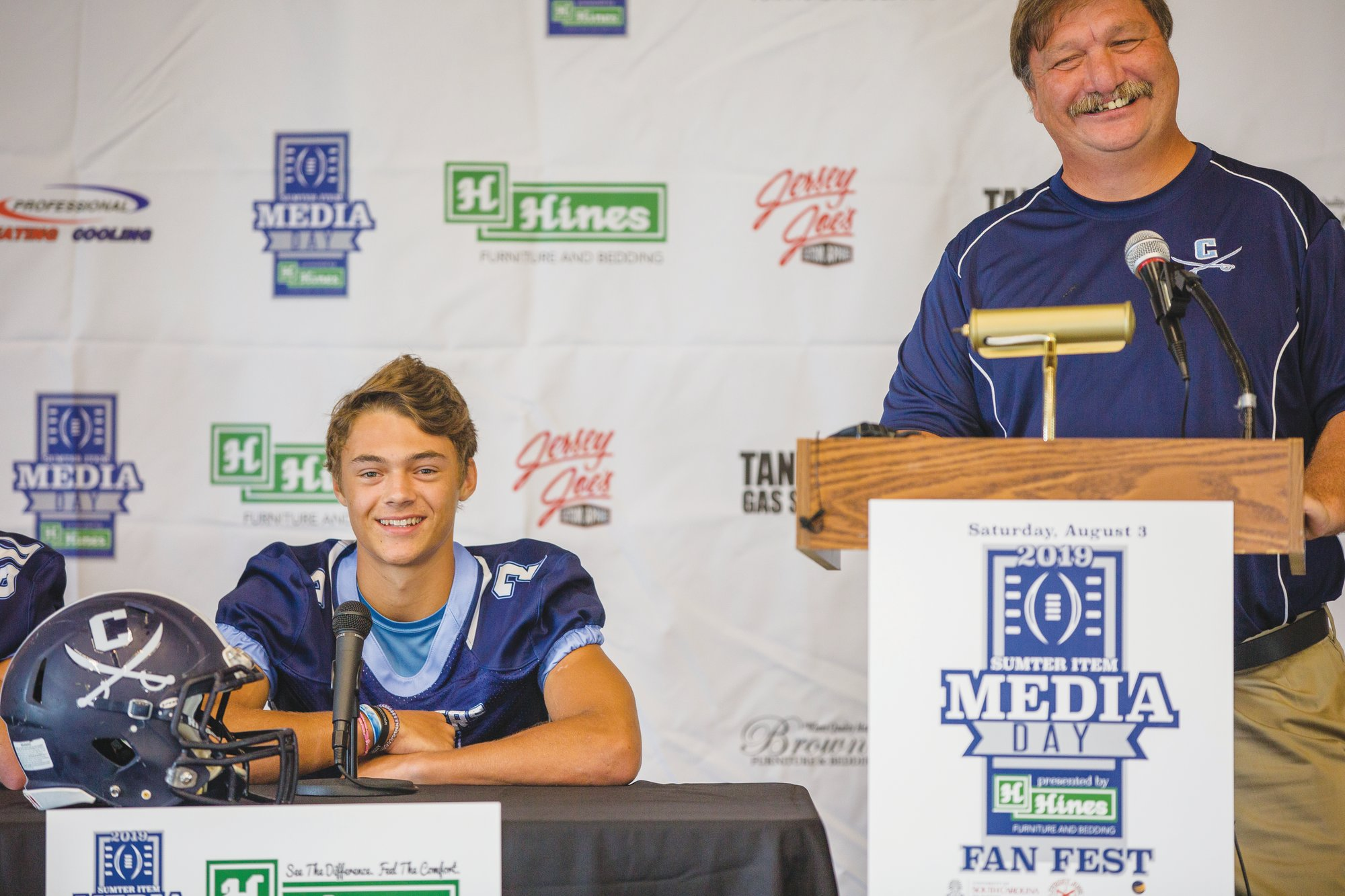 Robert E. Lee coach David Rankin, right, and Cavalier quarterback Jet Smith share a laugh at the 2019 Sumter Item Media Day.