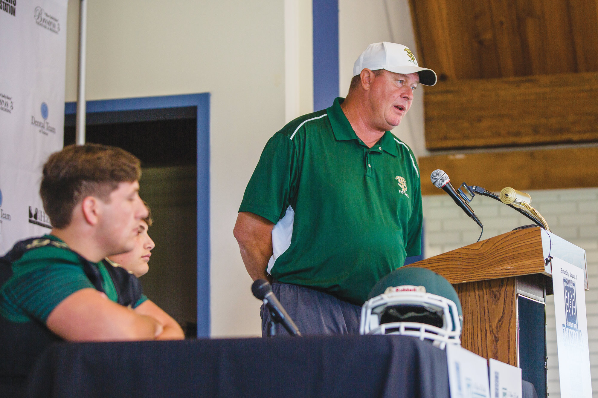 Randy Stogner, standing, talks at the 2019 Sumter Item Media Day. Stogner is entering his second year as the head football coach at Thomas Sumter.