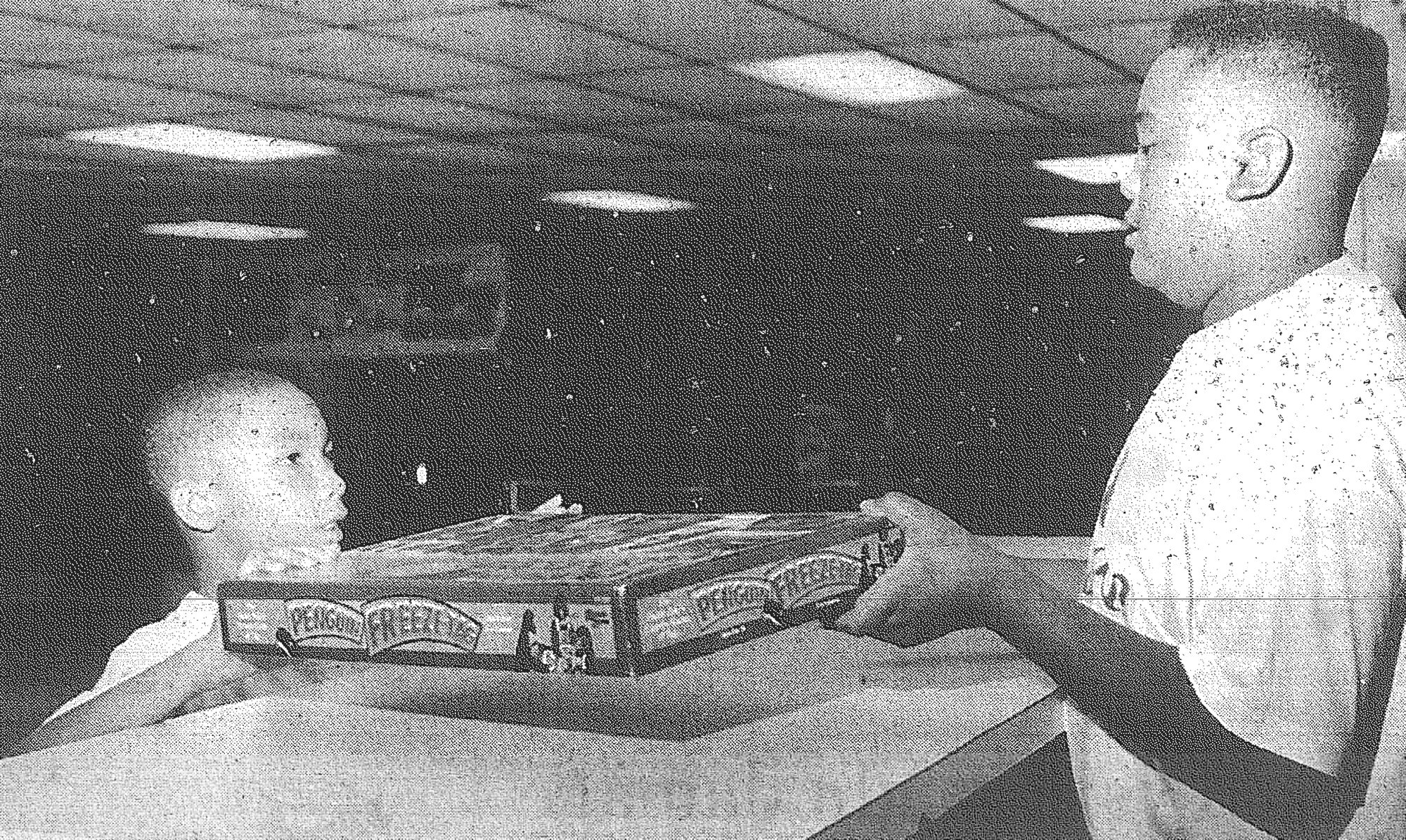1994 - Corey Pendergrass, 14, checks out a game to Keith Robinson, 8, in the Sumter Boys & Girls Club. Corey also tutored kids in math, settled disputes and acted as a role model for the kids at the youth center.