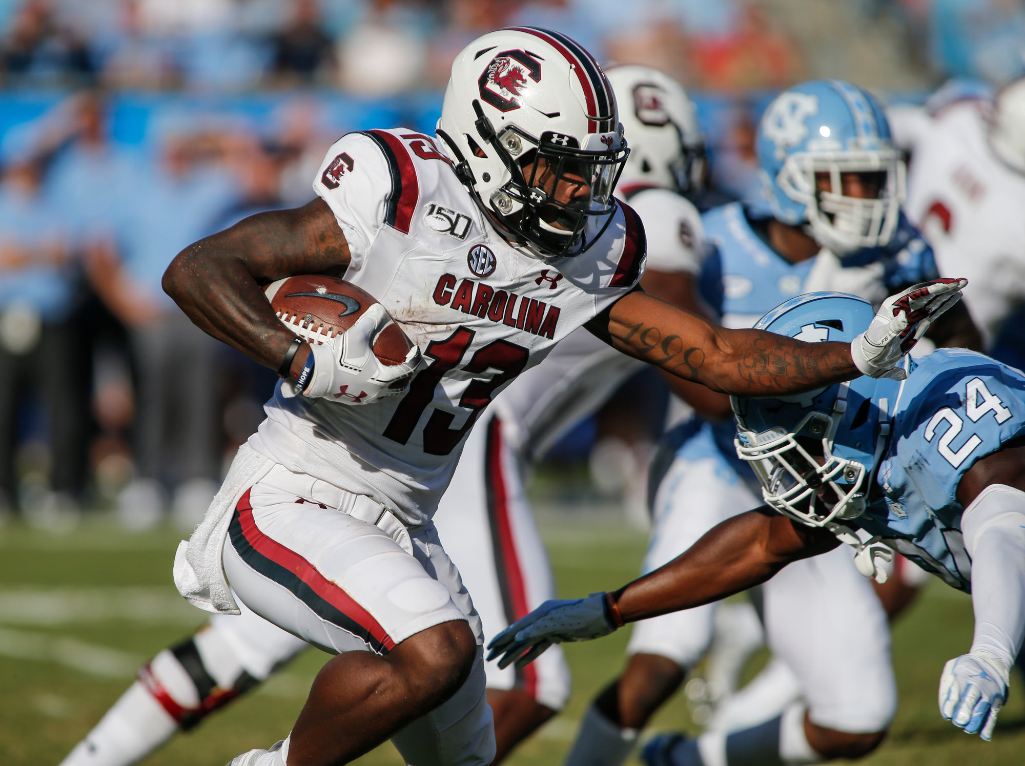 South Carolina wide receiver Shi Smith, left, looks for running room against North Carolina linebacker Eugene Asante in the second half of an NCAA college football game in Charlotte, N.C., Saturday, Aug. 31, 2019. North Carolina won 24-20. (AP Photo/Nell Redmond)
