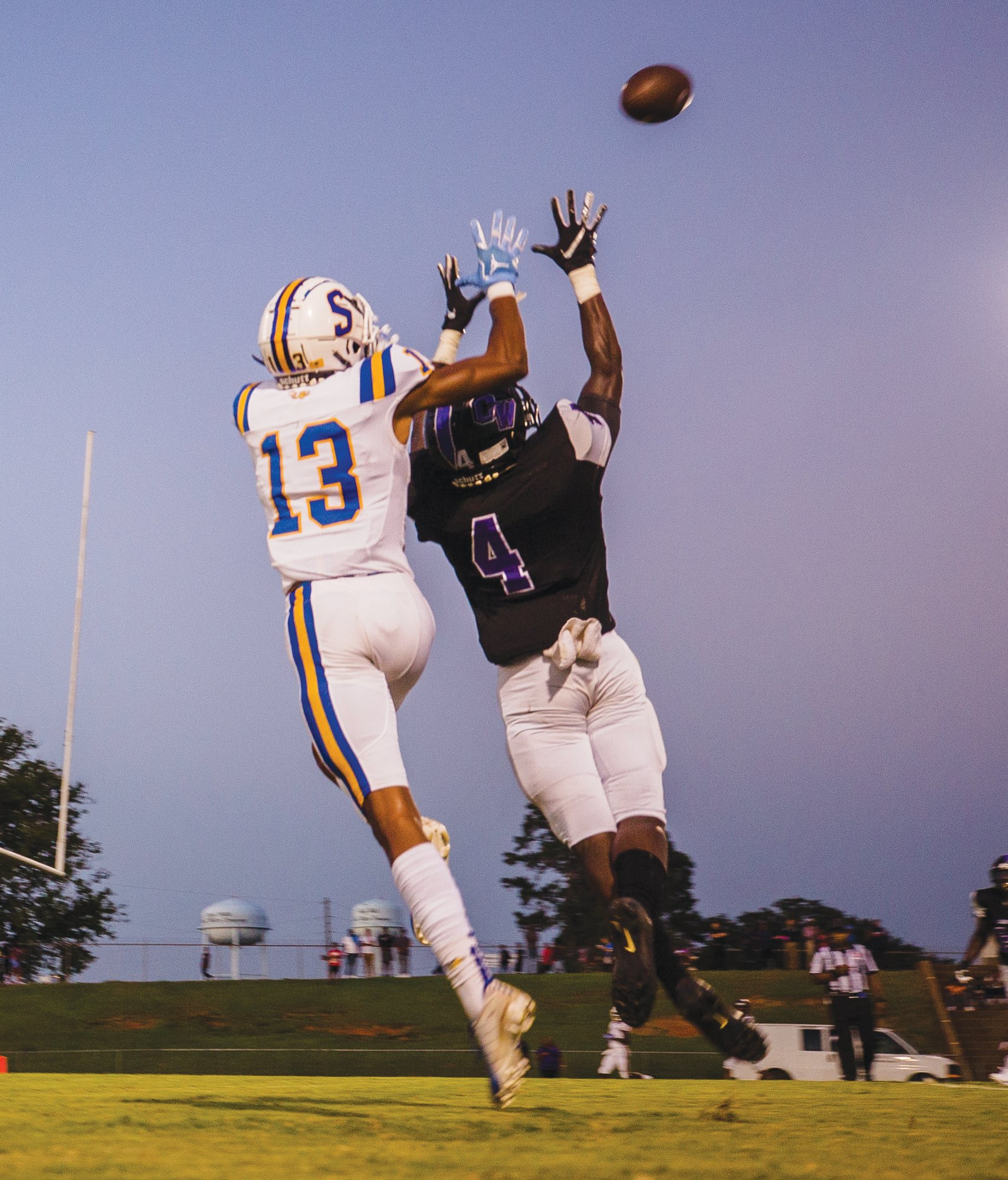 Sumter wide receiver Tylee Craft (13) goes up to make a catch over Crestwood defensive back Quinton Harrison in the Gamecock's 63-2 victory on Friday in Dalzell. Sumter's home game against Conway scheduled for Friday was canceled, but Crestwood is still scheduled to play at Richland Northeast.