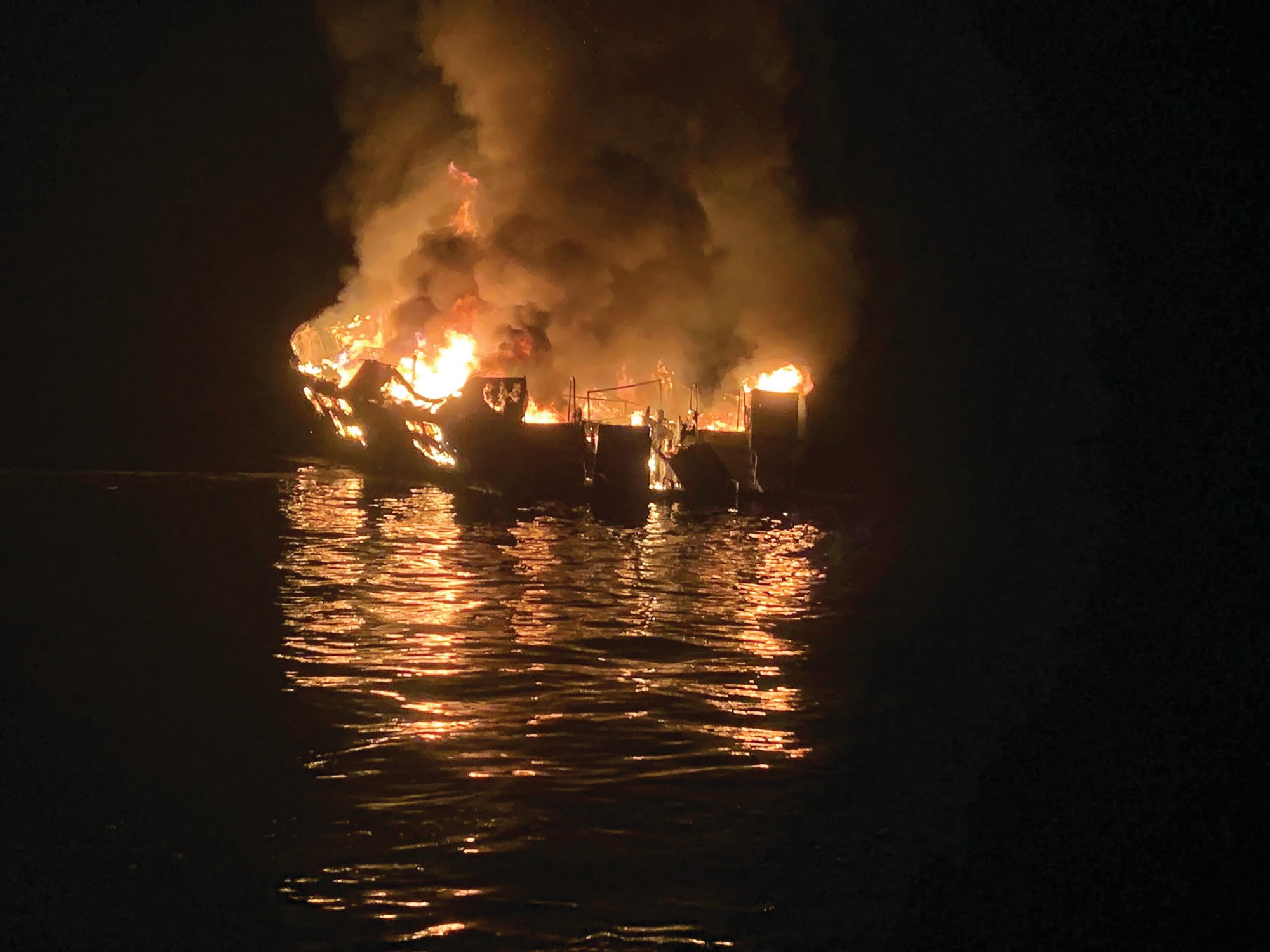 Santa Barbara County Fire Department via APA dive boat is engulfed in flames after a deadly fire broke out aboard the commercial scuba diving vessel off the Southern California Coast, Monday morning, Sept. 2, 2019.