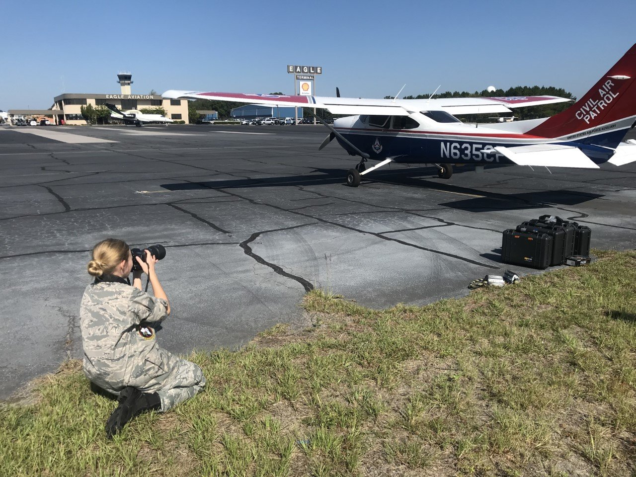 A cadet from the ACE Basin Composite Squadron takes photos of pilots getting ready to complete the aerial photography missions.