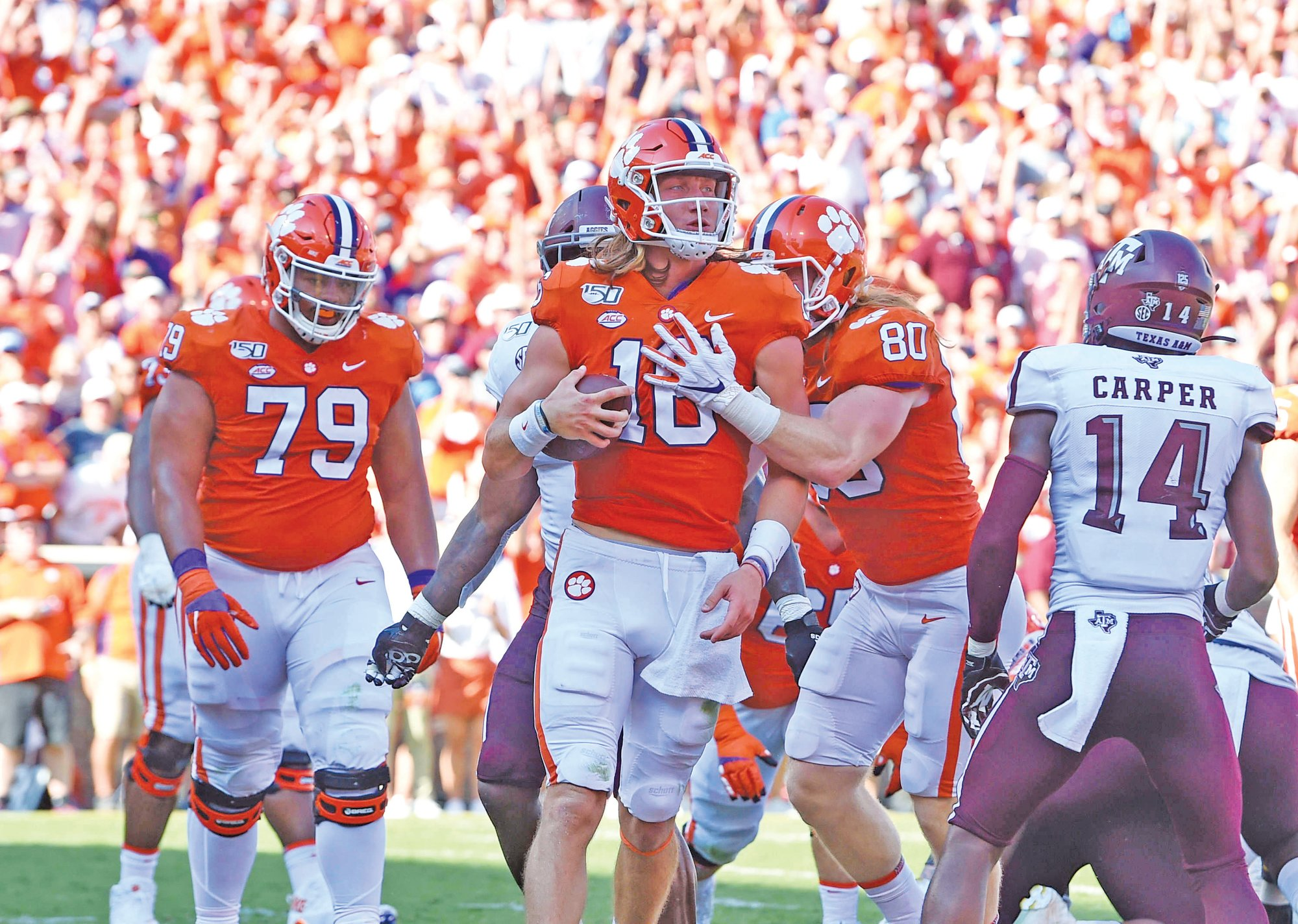 Clemson quarterback Trevor Lawrence (16) and the Tigers will be on the road against Syracuse on Saturday. Clemson is off to a 2-0 start after beating Texas A&M last week.
