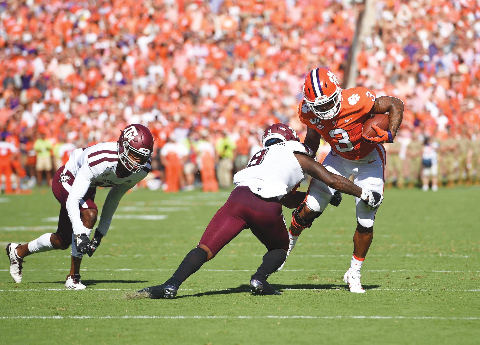 Clemson's Amari Rodgers (3) rushes while defended by Texas A&M's Leon O'Neal Jr. during the second half of an NCAA college football game Saturday, Sept. 7, 2019, in Clemson, S.C. Clemson won 24-10.