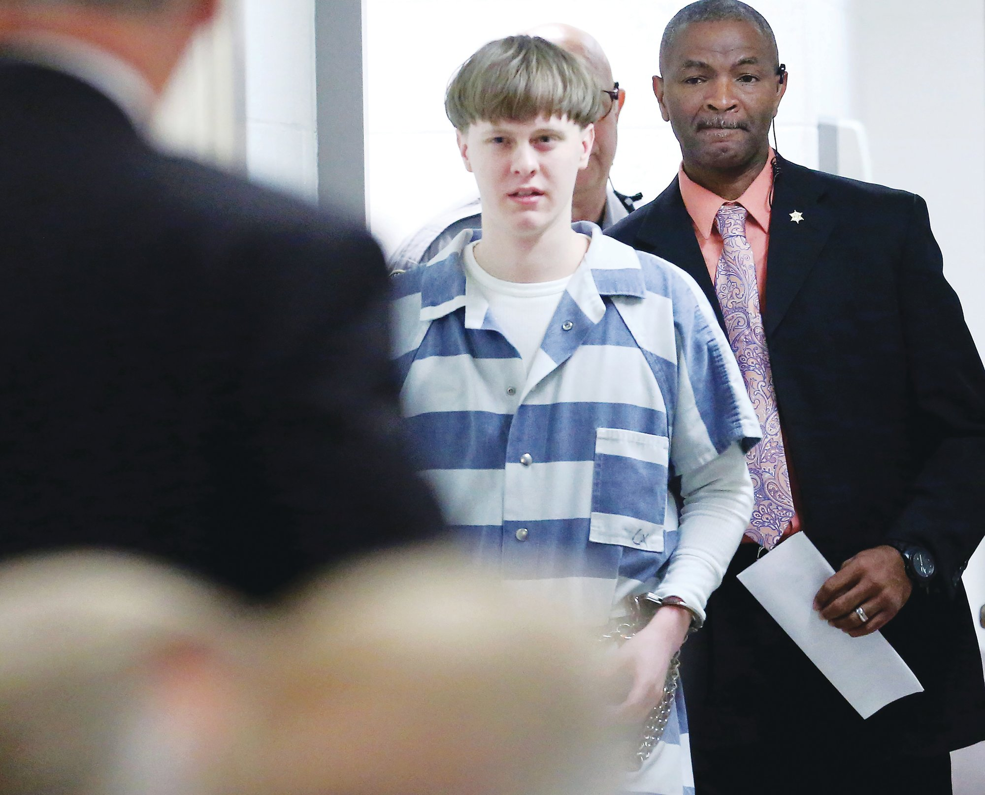 Dylann Roof enters the court room at the Charleston County Judicial Center on April 10, 2017, to enter his guilty plea on murder charges in Charleston.