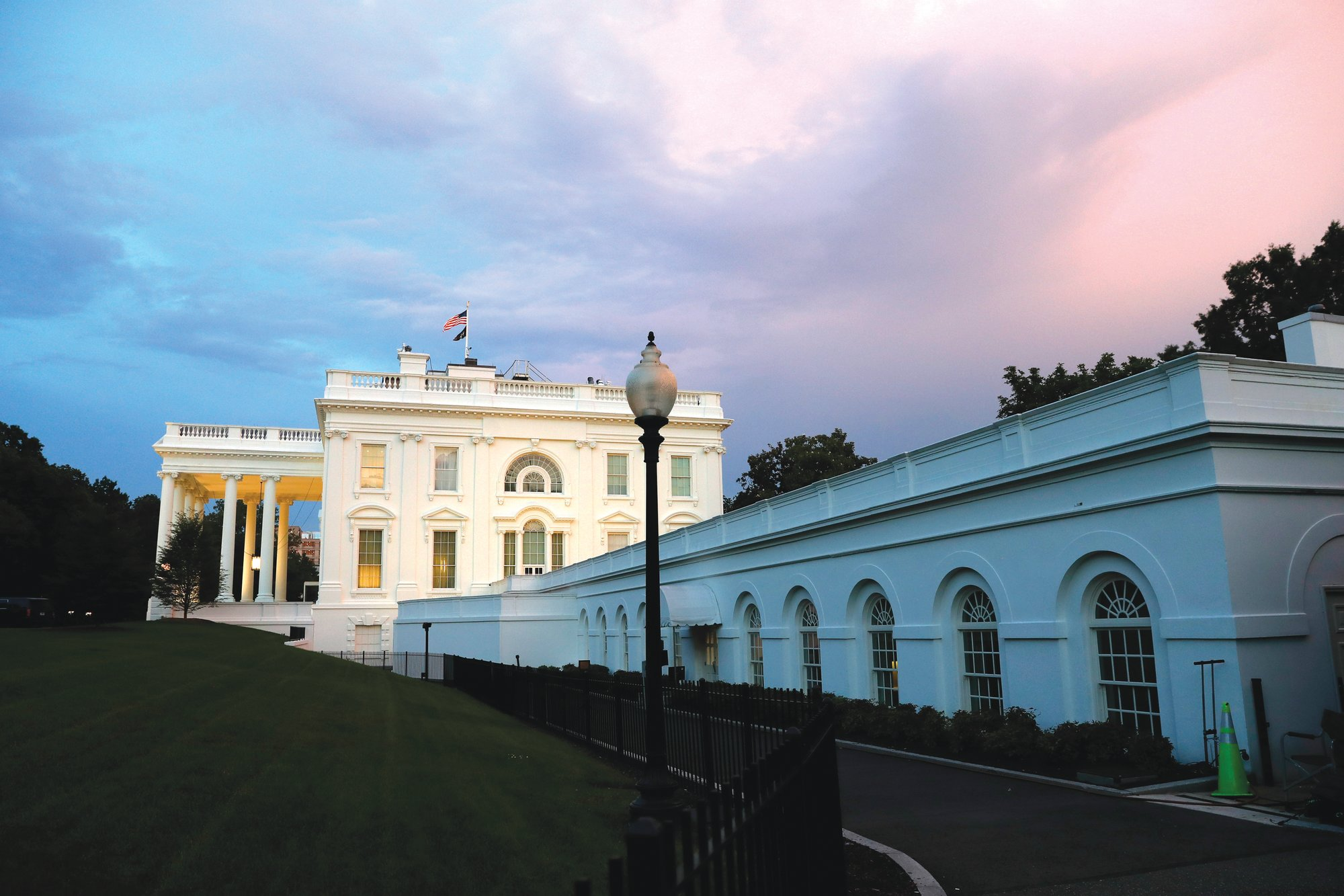 THE ASSOCIATED PRESS  Sunset colors fill the sky over the White House on May 18 in Washington. Hubert D. Osteen, editor and publisher of The Sumter Daily Item, was invited to the White House in 1963.