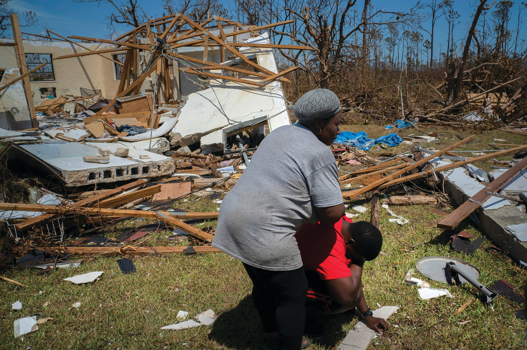 THE ASSOCIATED PRESSA woman comforts a man who cries after discovering his shattered house and not knowing anything about his 8 relatives who lived in the house, missing in the aftermath of Hurricane Dorian, in High Rock, Grand Bahama, Bahamas, on Sept. 5.