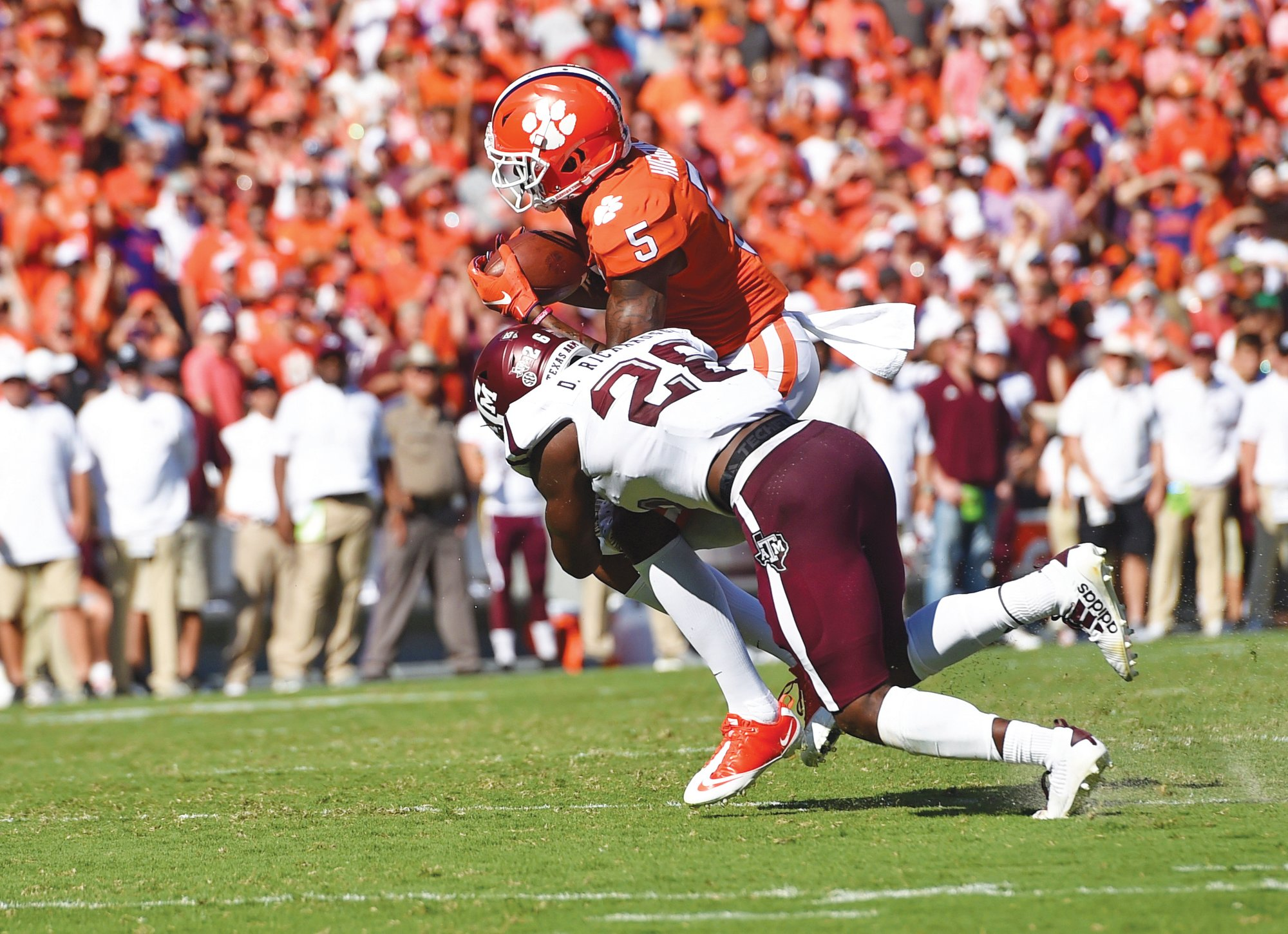 THE ASSOCIATED PRESSClemson wide receiver Tee Higgins (5) catches a pass in the Tigers' 24-10 win over Texas A&M last week. The top-ranked Tigers play at Syracuse on Saturday.
