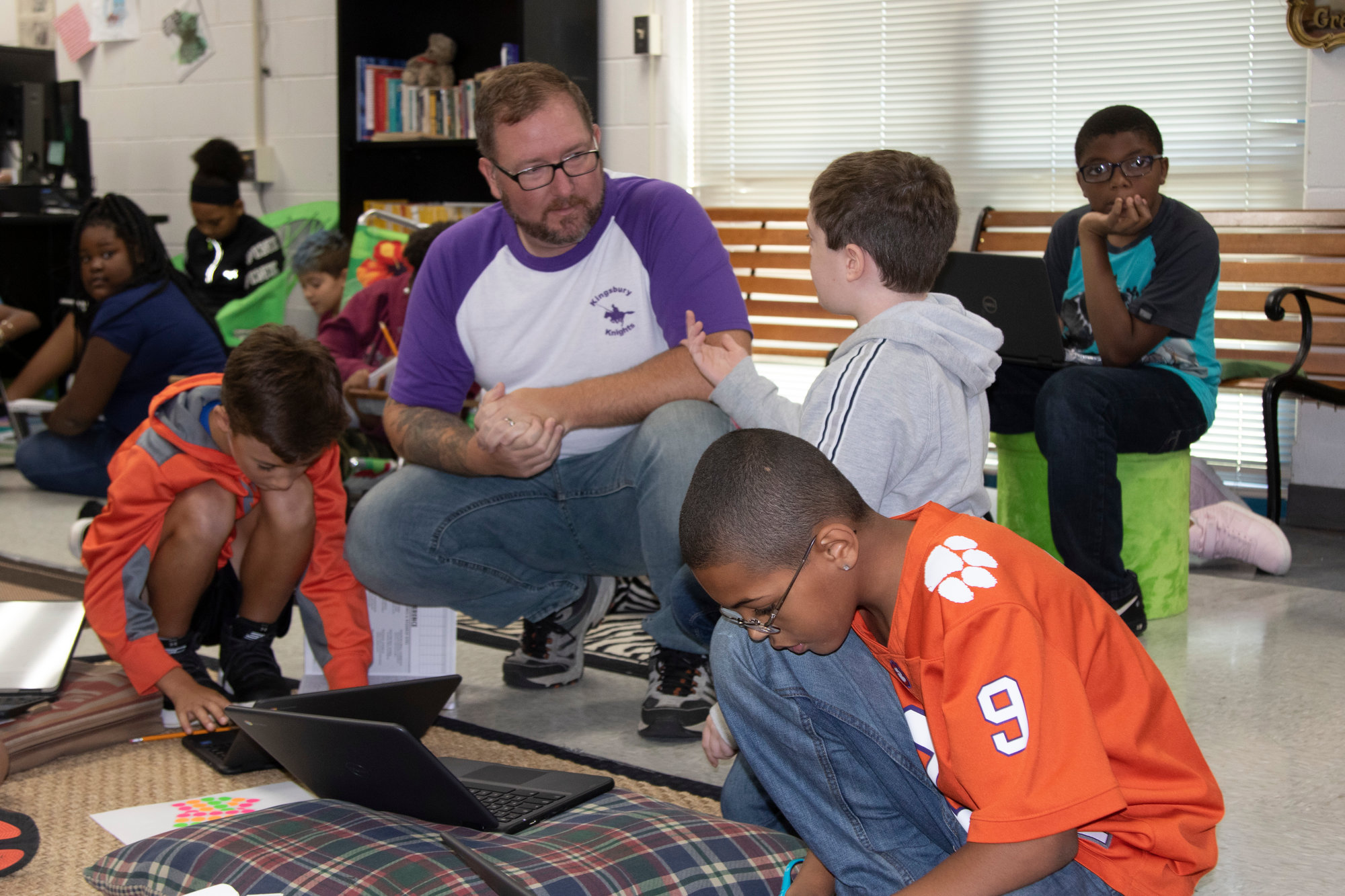 Leroy Steigerwalt helps his fifth-grade students understand a problem-solving question.