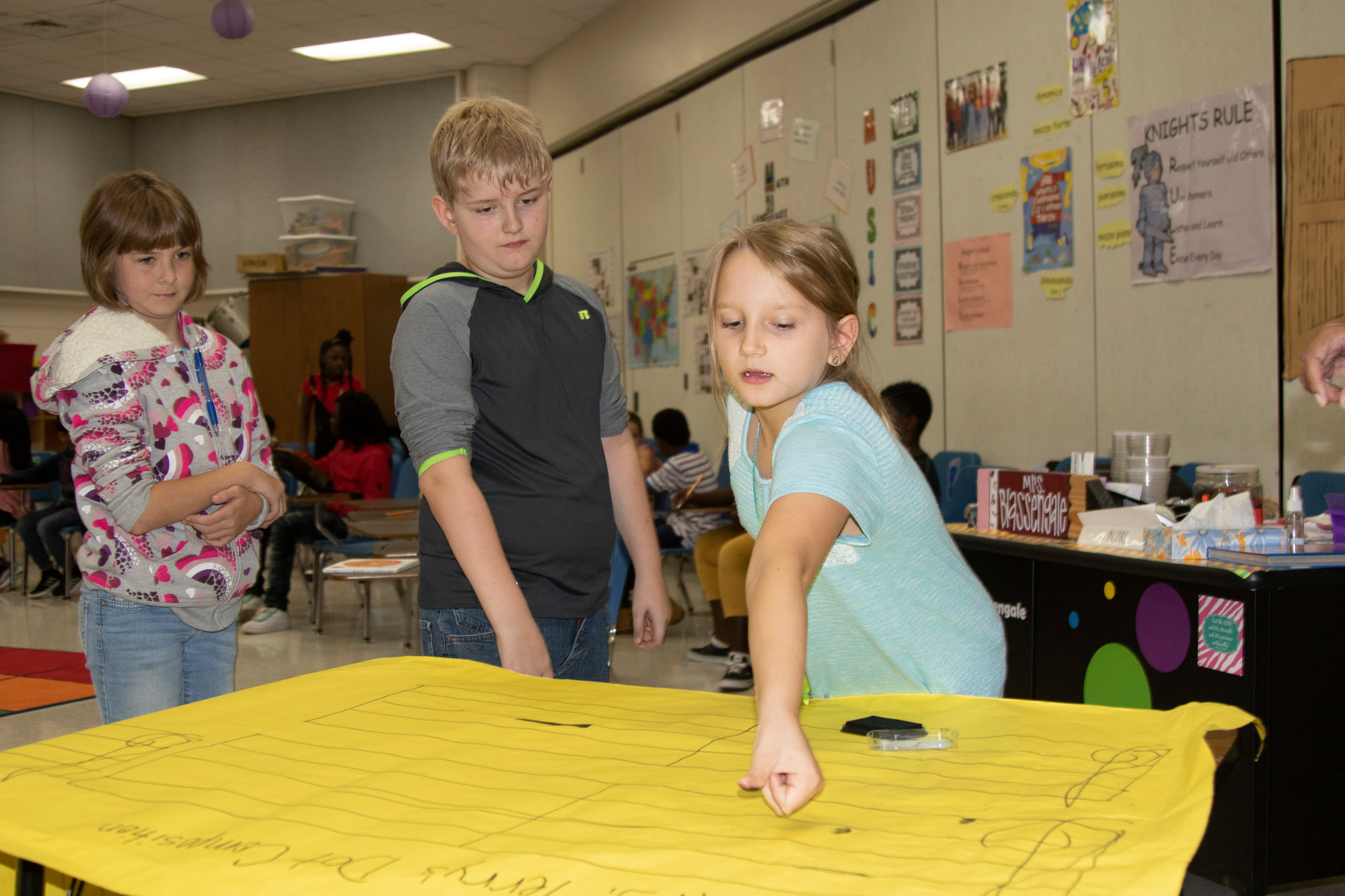 Kingsbury Elementary School students make their mark in music class with fingerprint dots.