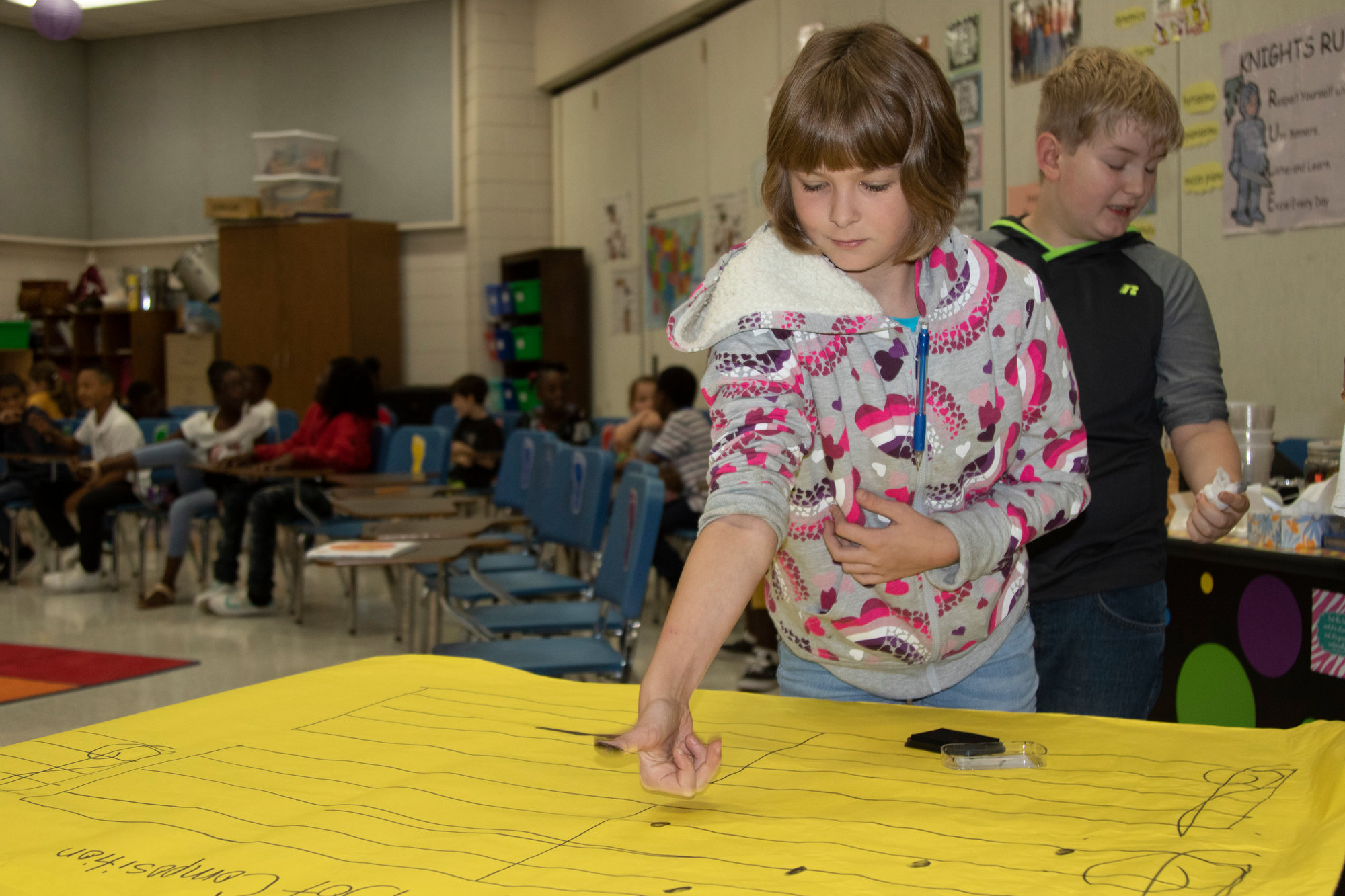 Kingsbury Elementary students make their mark in music class with fingerprint dots.