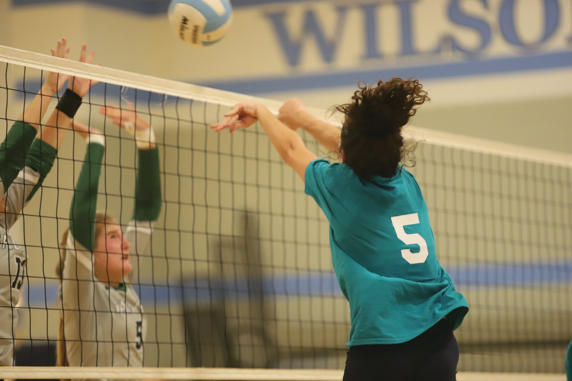 J. SCOTT SEWELL / The Sumter Item  Wilson Hall's Lucy Matthews goes for a kill in the Lady Barons' 3-2 victory over Ben Lippen on Thursday. Wilson Hall is 10-4 on the season.