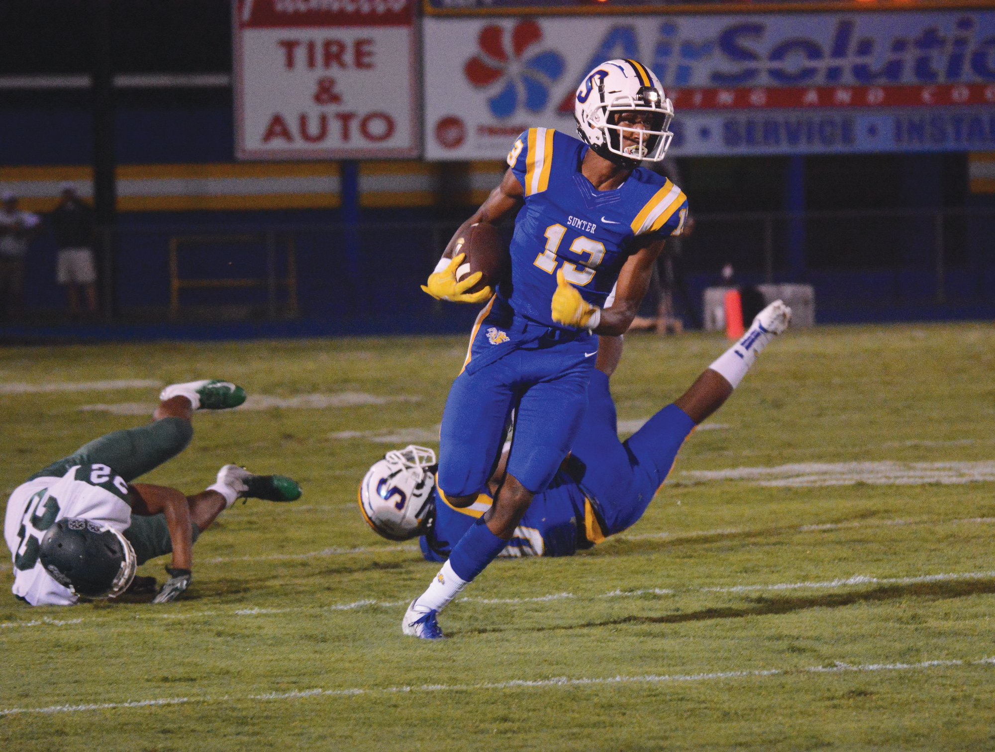 TIM LEIBLE / THE SUMTER ITEM  Sumter's Tylee Craft (13) turns up the field on a punt return in the Gamecocks' 61-0 victory over Lakewood on Friday at Memorial Stadium's Freddie Solomon Field.