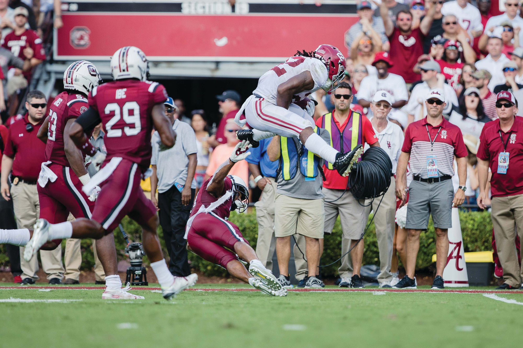 MICAH GREEN / THE SUMTER ITEM  Alabama running back Najee Harris leaps over a South Carolina defender on the way to a 42-yard touchdown pass in the Crimson Tide's 47-23 victory on Saturday at Williams-Brice Stadium in Columbia.