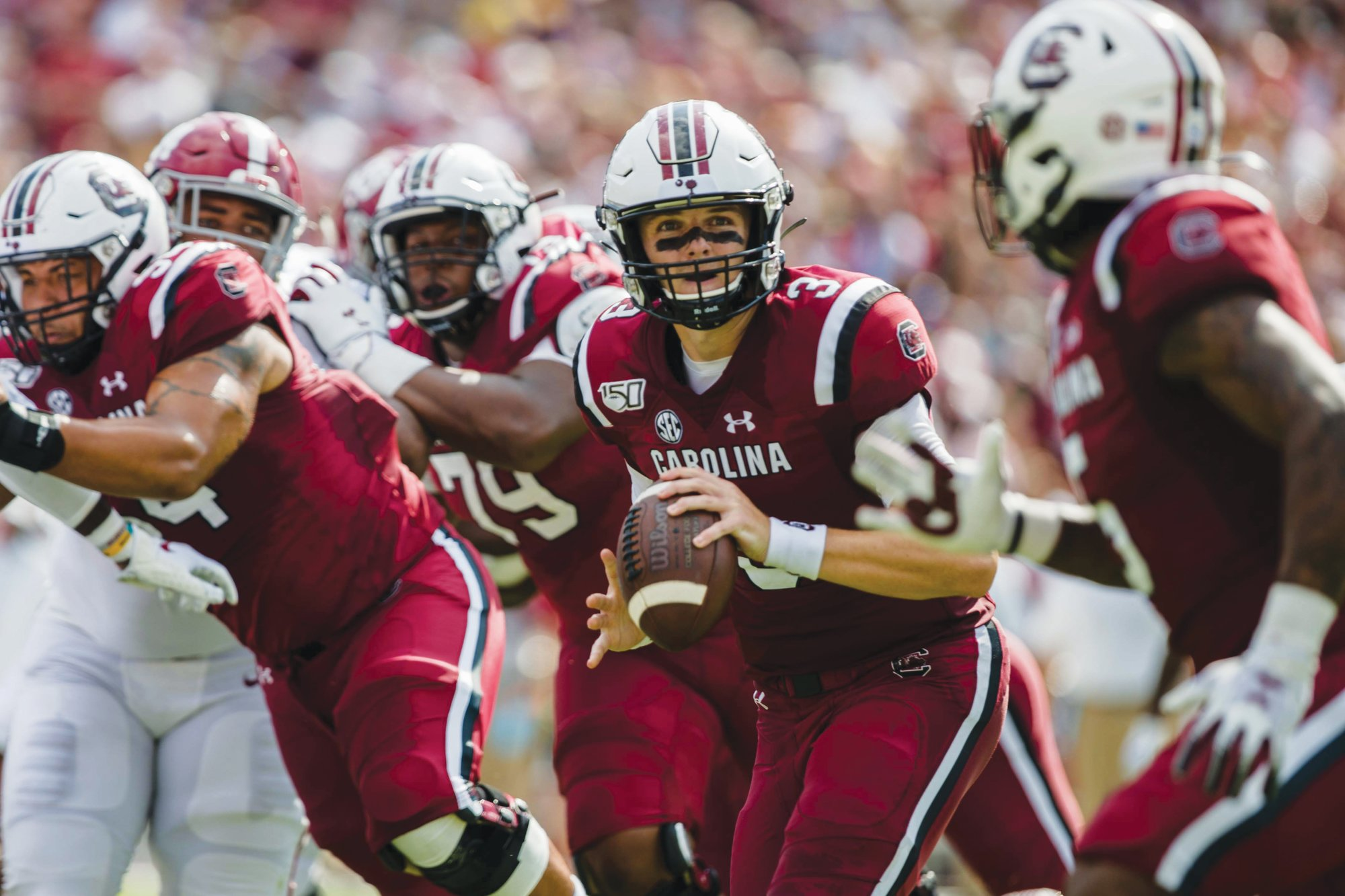 MICAH GREENSouth Carolina quarterback Ryan Hilinski, center, looks to pitch the ball to running back Rico Dowdle during the Gamecocks' 47-23 loss to Alabama on Saturday in Columbia. USC will be on the road against Missouri this Saturday.