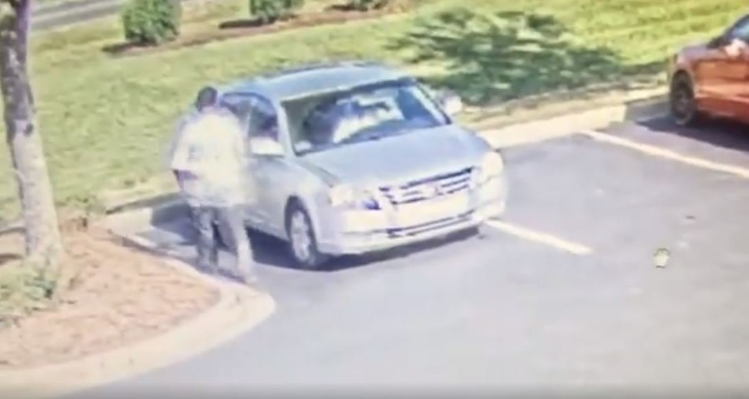 The robber was seen getting into the passenger side of this vehicle, which is possibly a Toyota Avalon, police say.
