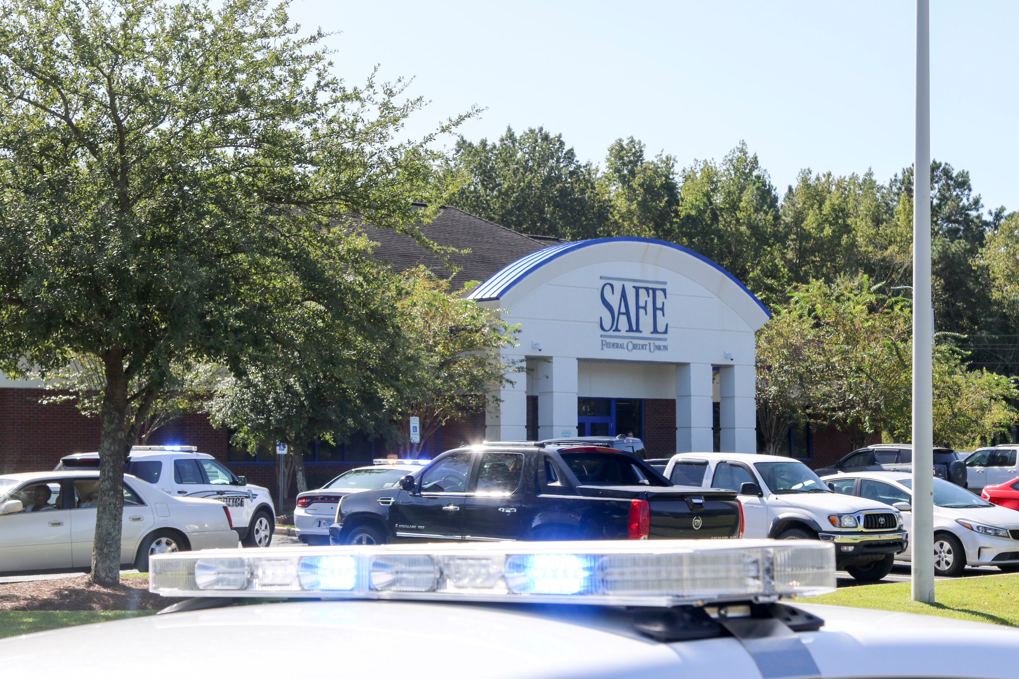 Police were on scene Friday morning as SAFE Federal Credit Union remained on lockdown after a robbery.
