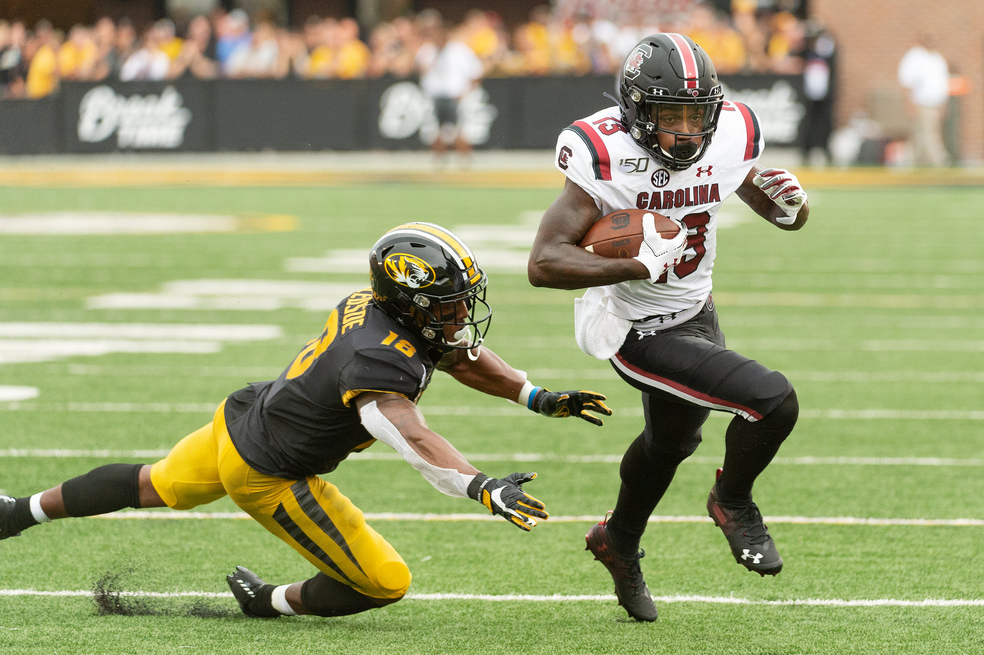 South Carolina wide receiver Shi Smith, right, runs past Missouri safety Joshuah Bledsoe, left, during the third quarter of an NCAA college football game Saturday, Sept. 21, 2019, in Columbia, Mo.