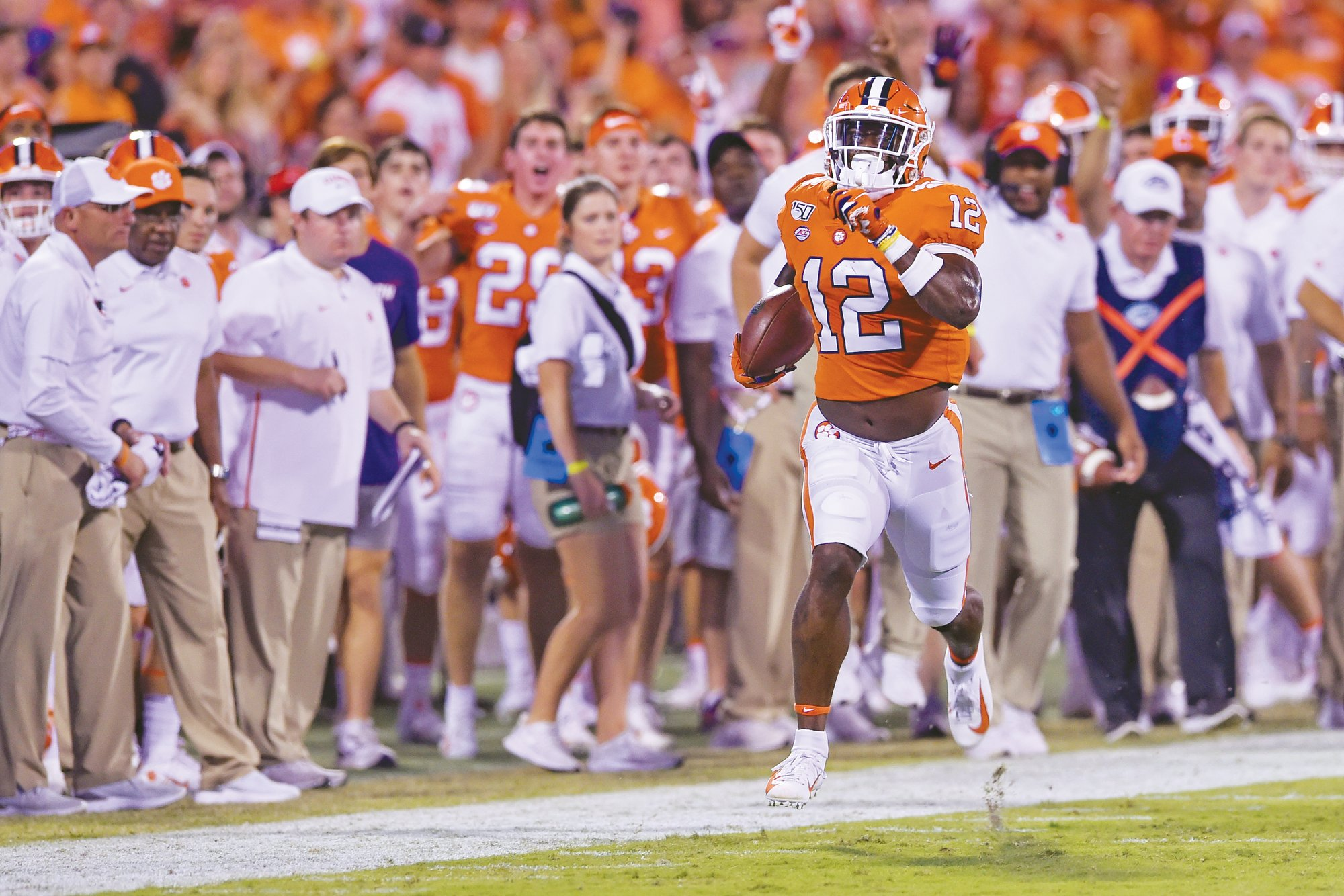 The Associated Press  Clemson's K'Von Wallace races down the sideline on an interception return for a touchdown in the Tigers' 52-10 win over Charlotte last Saturday in Clemson. The Tigers will be going for their 20th straight victory on Saturday on the road against North Carolina.