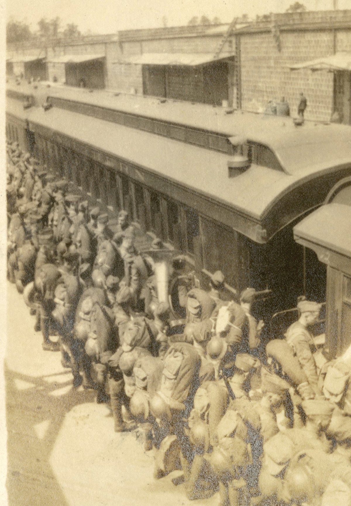 PHOTO PROVIDED BY THE SOUTH CAROLINA HISTORICAL SOCIETY  Soldiers board a train for Camp Jackson (later named Fort Jackson).  More than 26% of U.S. servicemen suffered from influenza in World War I.