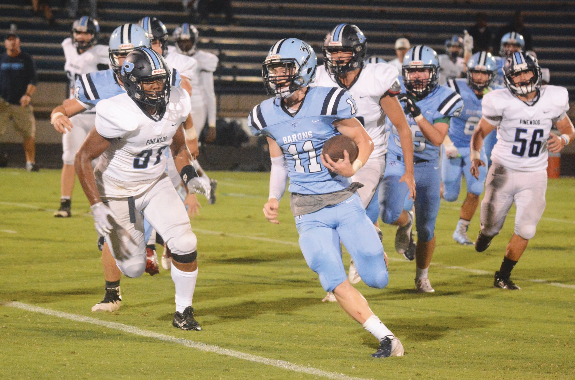 Wilson Hall's Emory Moore (11) ran for 150 yards and two scores, while also catching two passes for 42 yards in last week's 30-14 win over Pinewood Prep. He'll look to build on that strong performance as the Barons host Ben Lippen on Friday.