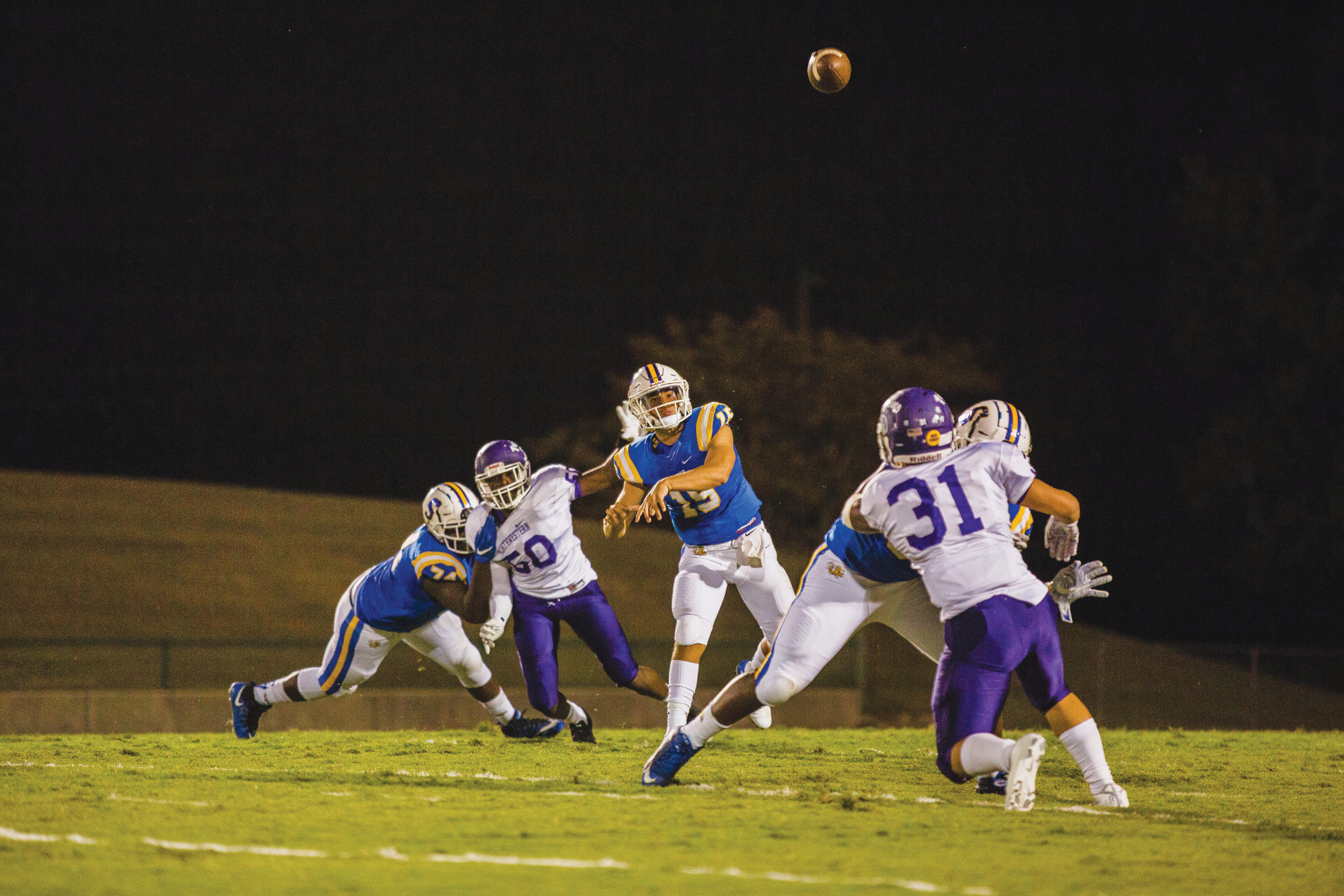Sumter quarterback Hayden Vasquez, center, will look to keep the high-powered Gamecock offense clicking as they play host Lugoff-Elgin on Friday.
