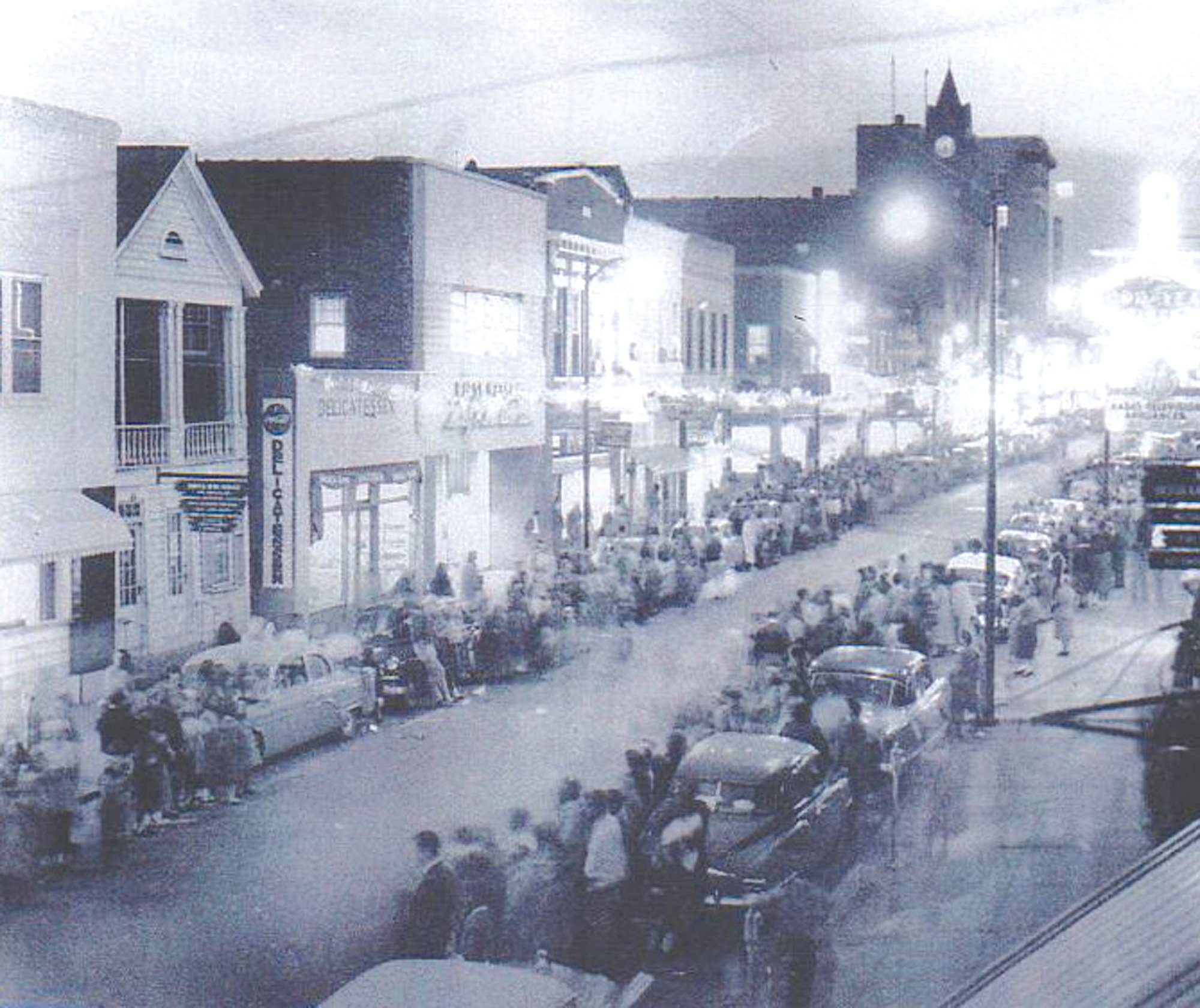 The Elizabeth White house, the building second from left, is seen next to a deli in downtown Sumter during a parade. It was thought to be one of Sumter's oldest dwellings at the time it was torn down in 1956 to make space for a new brick men's haberdashery shop.