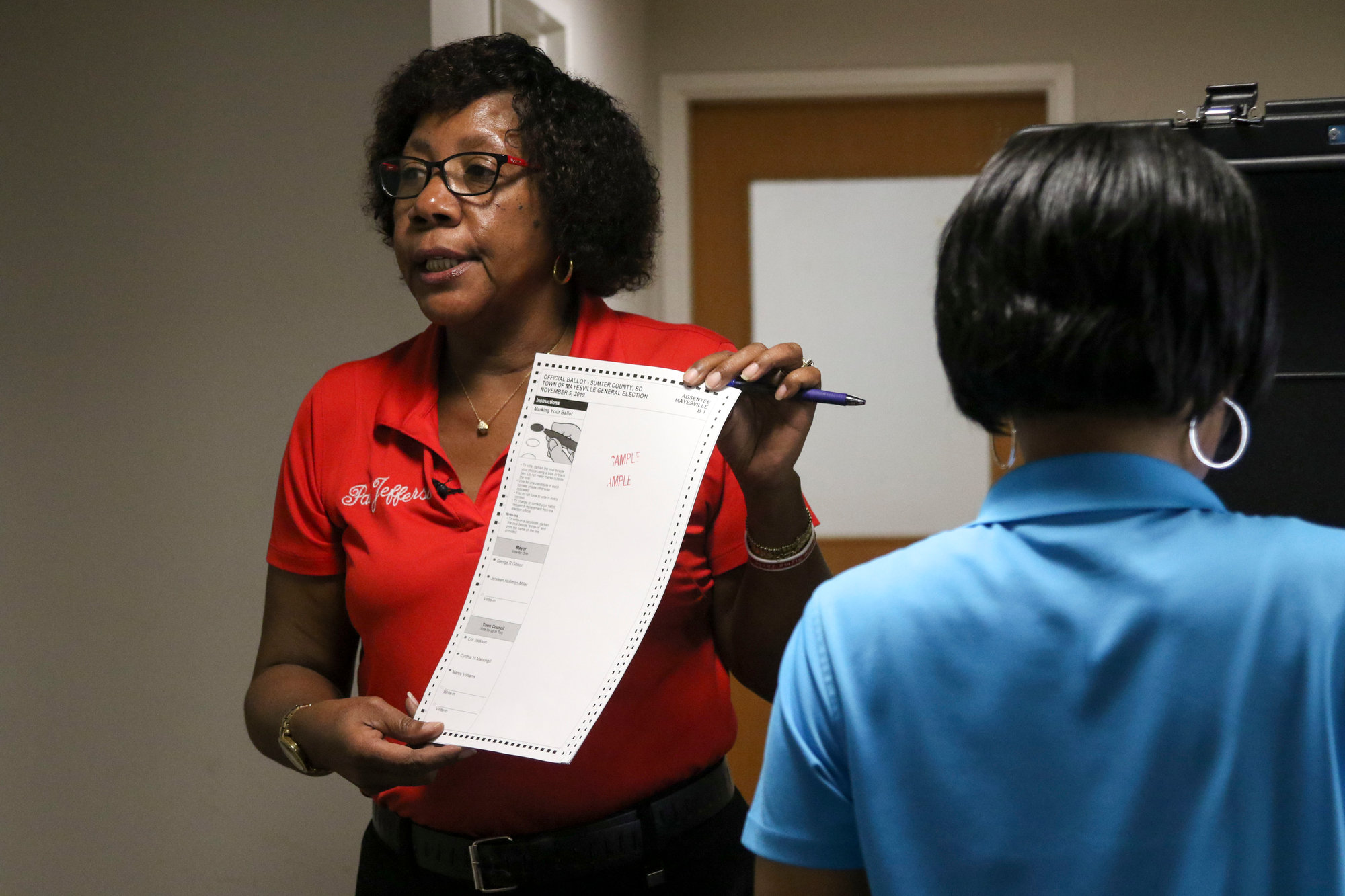Pat Jefferson, director of Sumter County Voter Registration and Elections, displays a paper ballot that voters can elect to fill out instead of using the touchscreen.