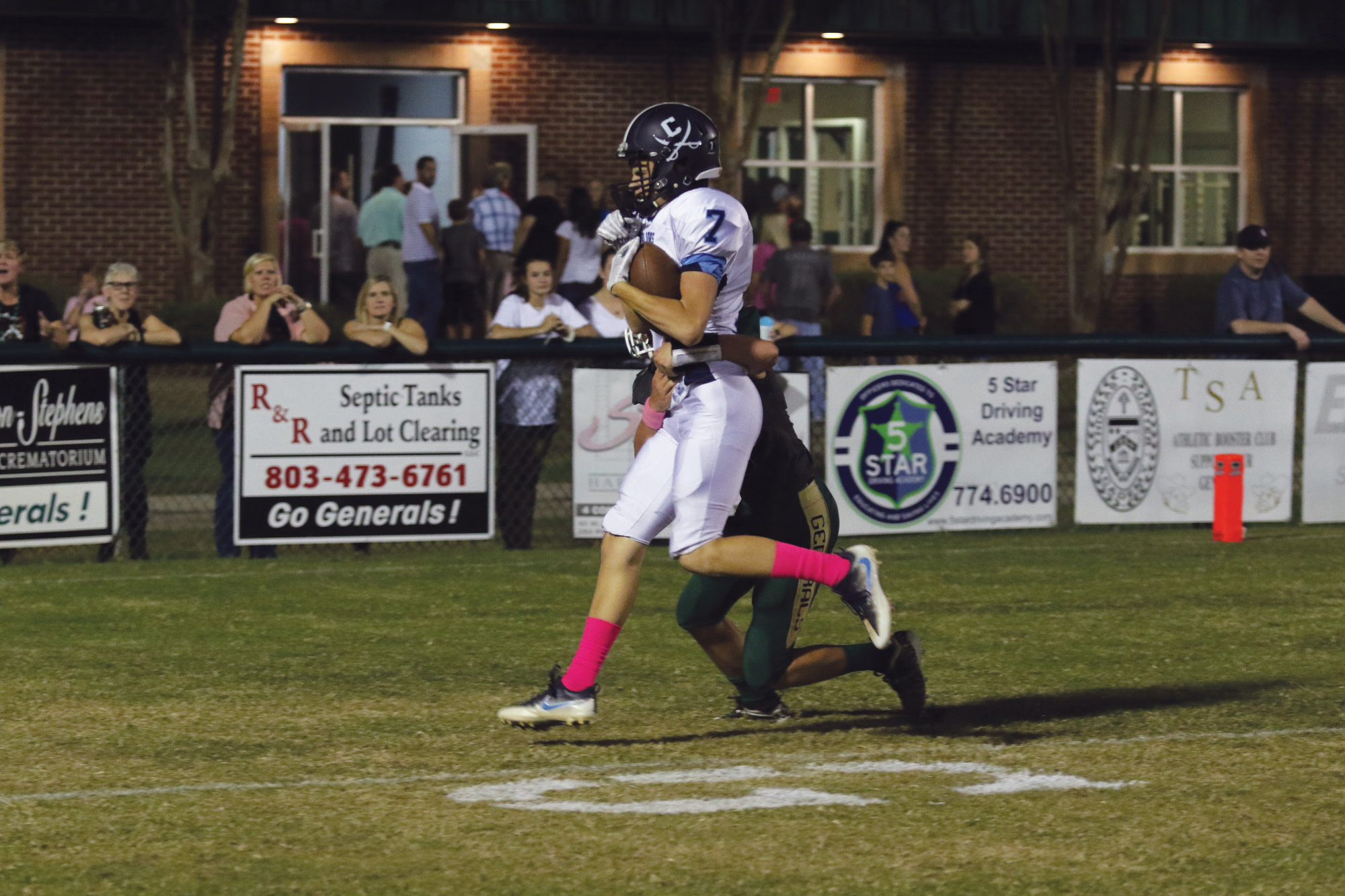 Morgan Brown scores on a 4-yard touchdown run to give Robert E. Lee a 33-0 lead early in the third quarter of the Cavaliers' 40-16 victory over Thomas Sumter Academy on Friday night at General Field.