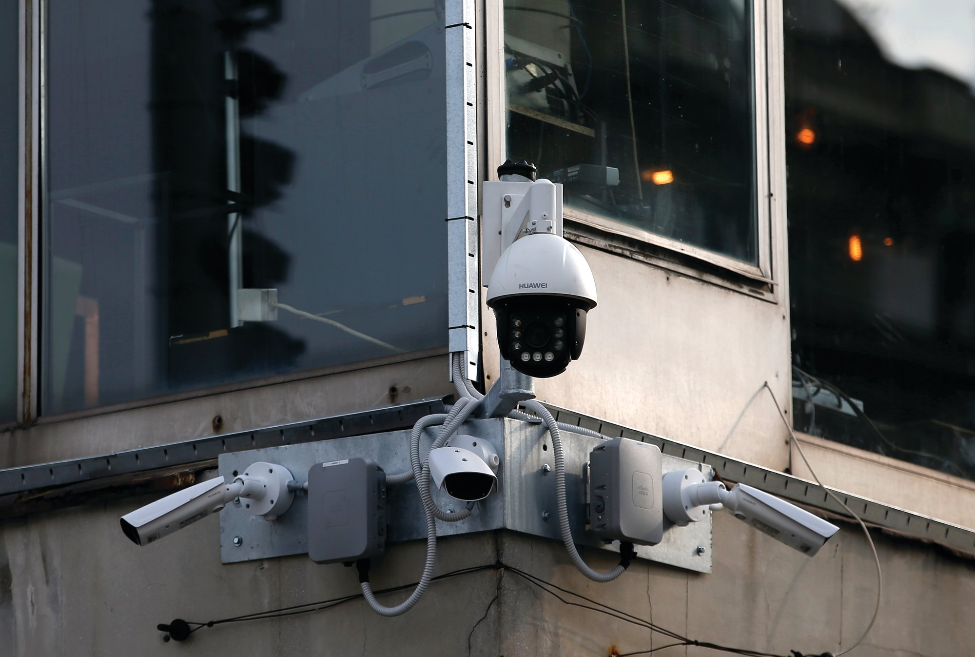 THE ASSOCIATED PRESS  High-tech video cameras hang from an office building in downtown Belgrade, Serbia. The cameras, equipped with facial recognition technology, are being rolled out across hundreds of cities around the world, particularly in poorer countries with weak track records on human rights where Beijing has increased its influence through big business deals.