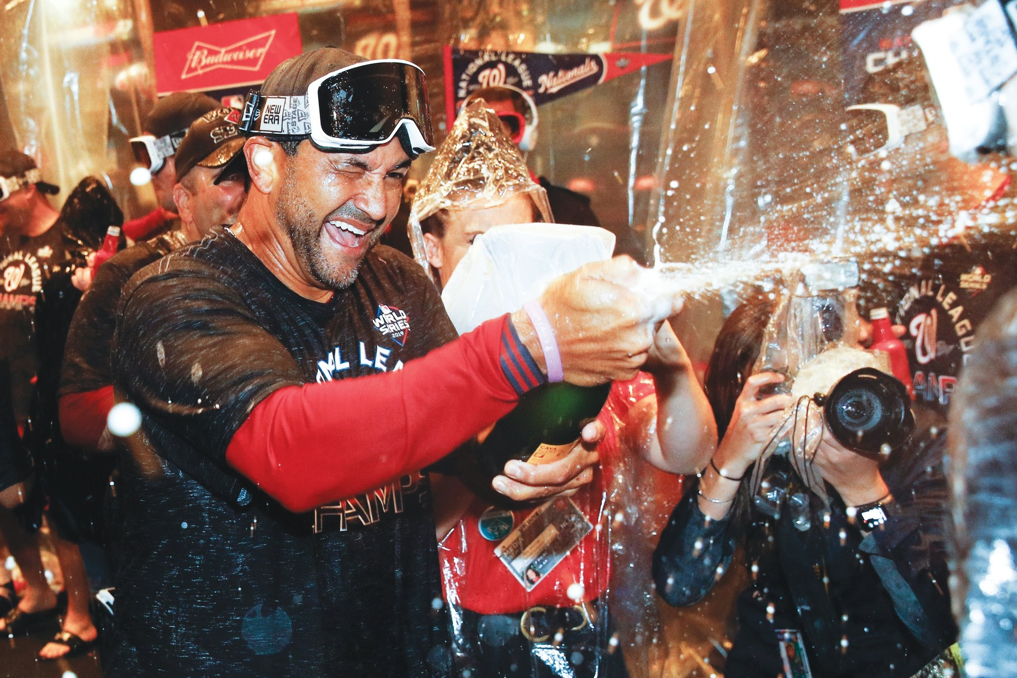 Washington Nationals manager Dave Martinez celebrates with his team after they completed a sweep of the St. Louis Cardinals in the National League Championship Series on Wednesday in Washington.