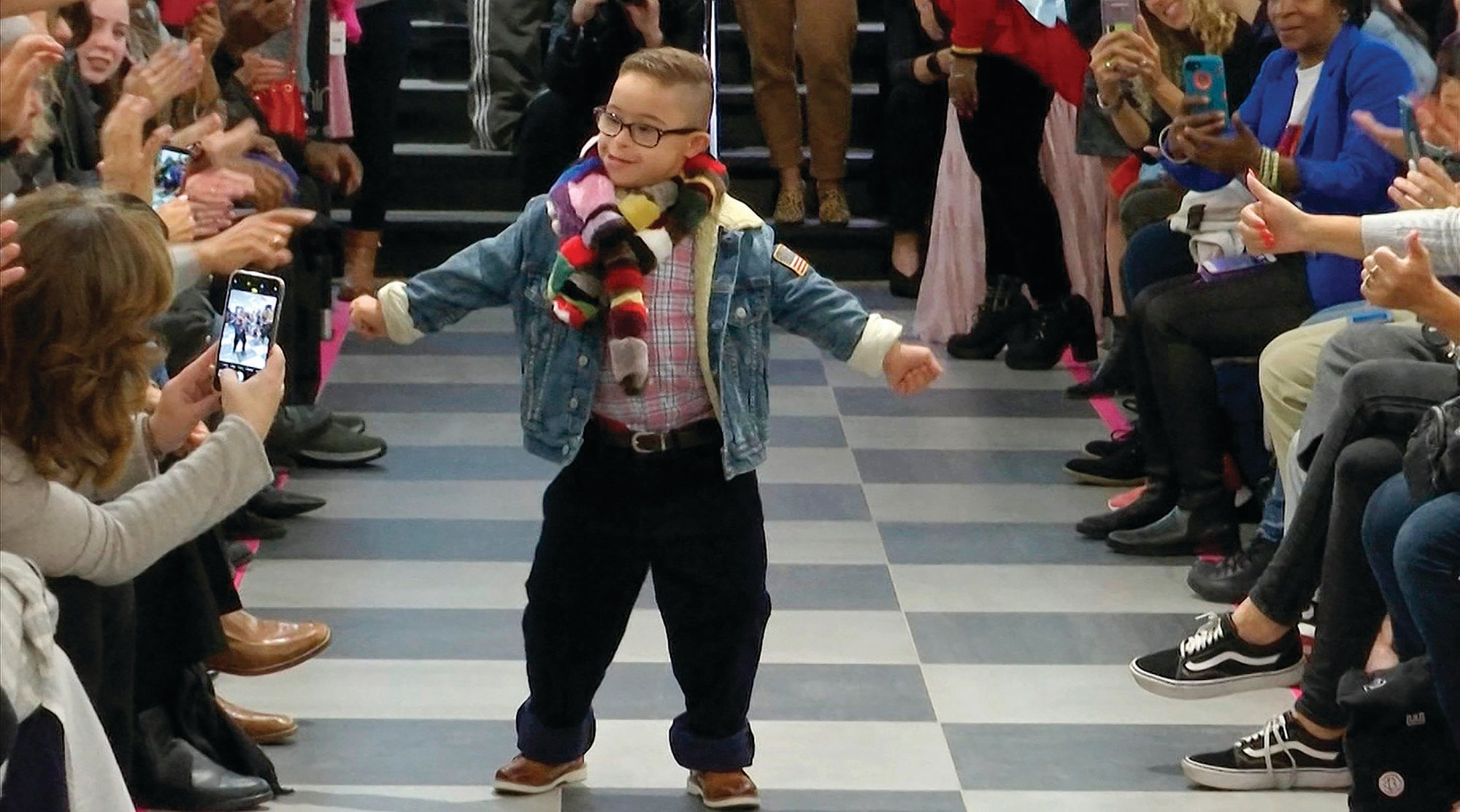 "A boy walks the runway in the second-annual ""Gigi's Playhouse Fashion Show"" in New York. Gigi's Playhouse is an education and achievement center that prepares young people with Down syndrome to engage more fully in their homes, schools and communities."