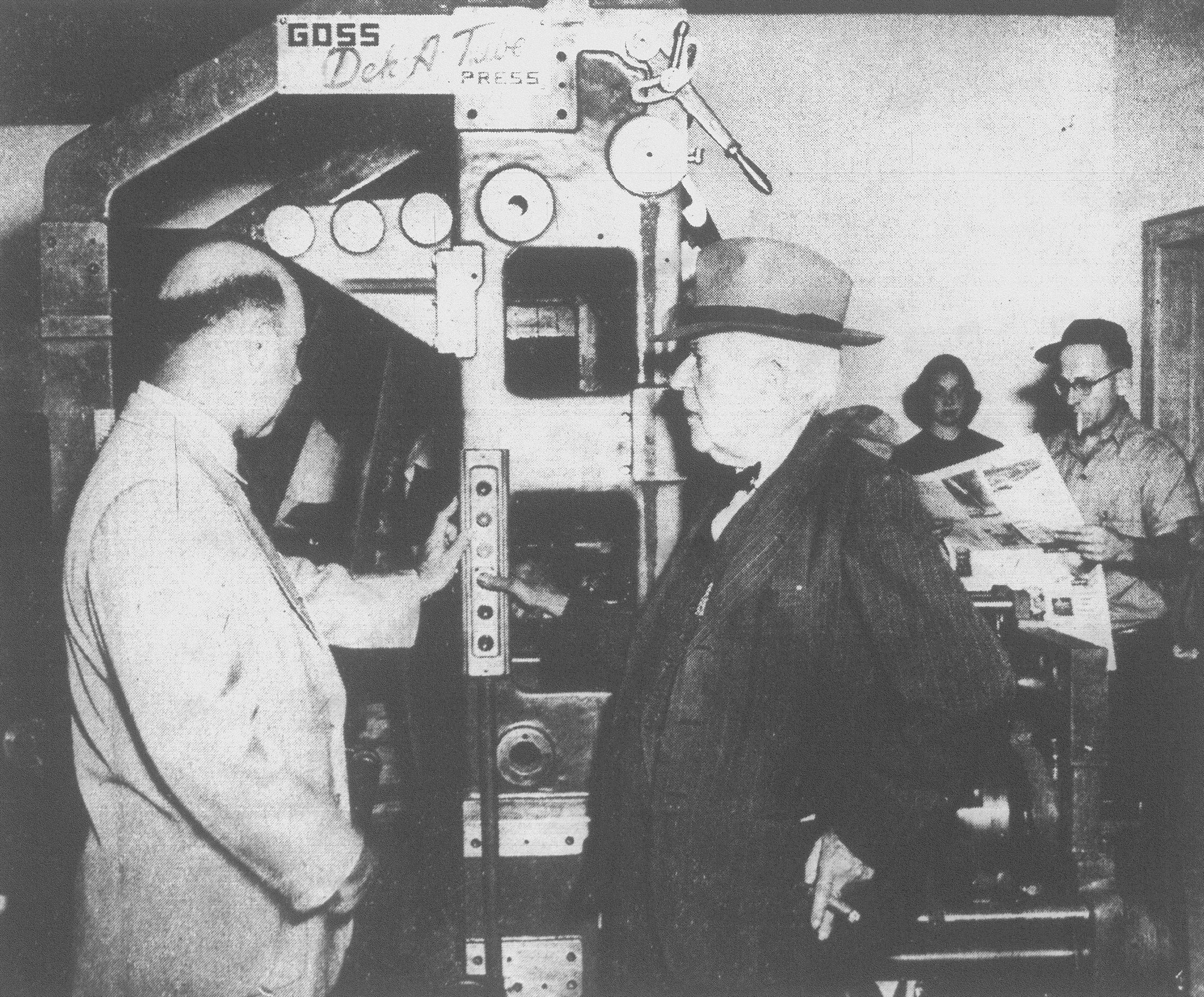H.G. Osteen, right, president of Osteen Publishing Co. and founder of The Sumter Daily Item, presses the button that starts the papers rolling off the new Goss press for the first edition of the Item printed in its new home Oct. 26, 1953. Looking on is H.D. Osteen, editor and publisher of the paper.