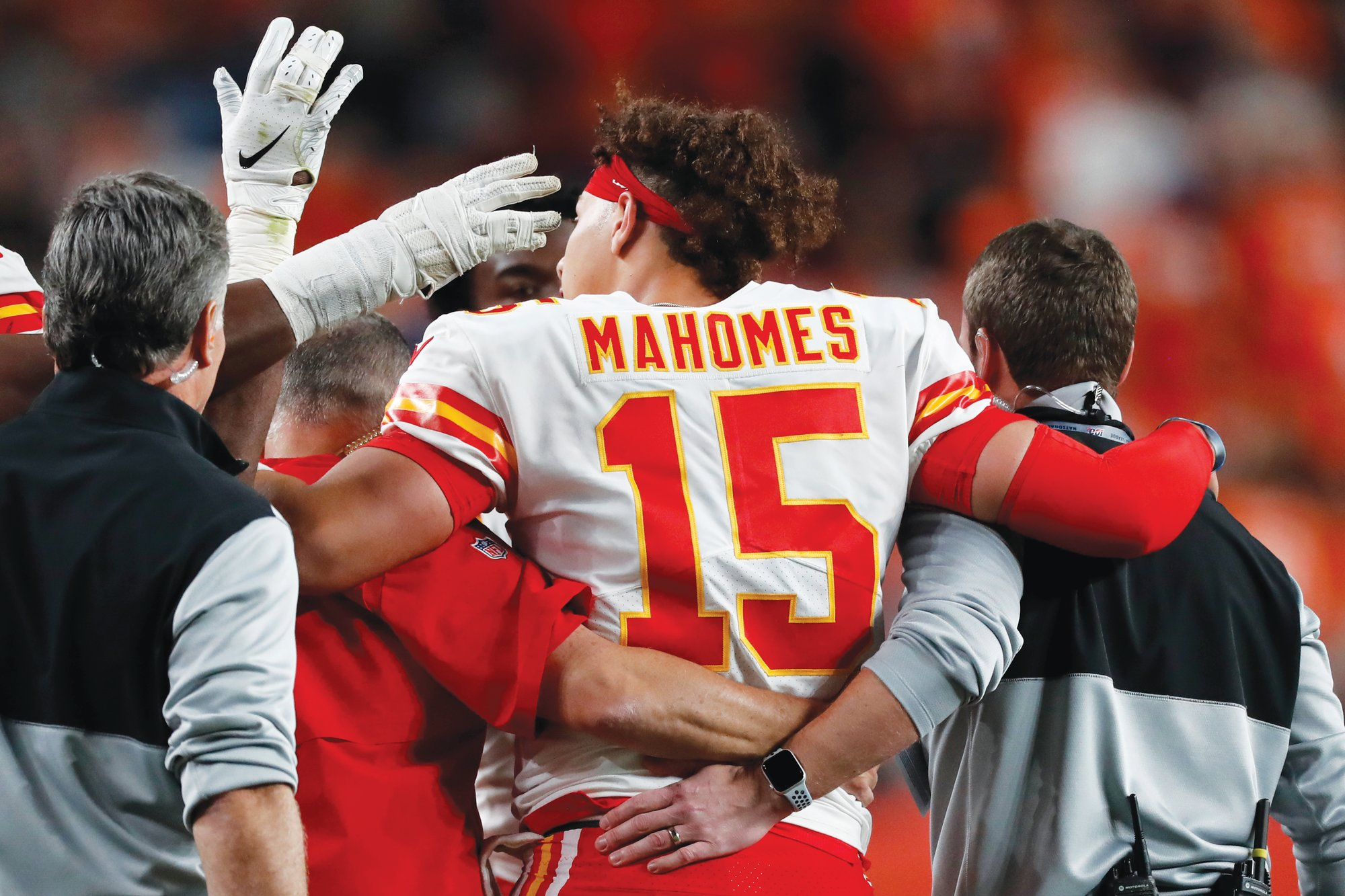 Kansas City quarterback Patrick Mahomes (15) is helped off the field after dislocating his right kneecap in the Chiefs' 30-6 win over Denver on Thursday in Denver. Mahomes is expected to miss between four to six weeks.