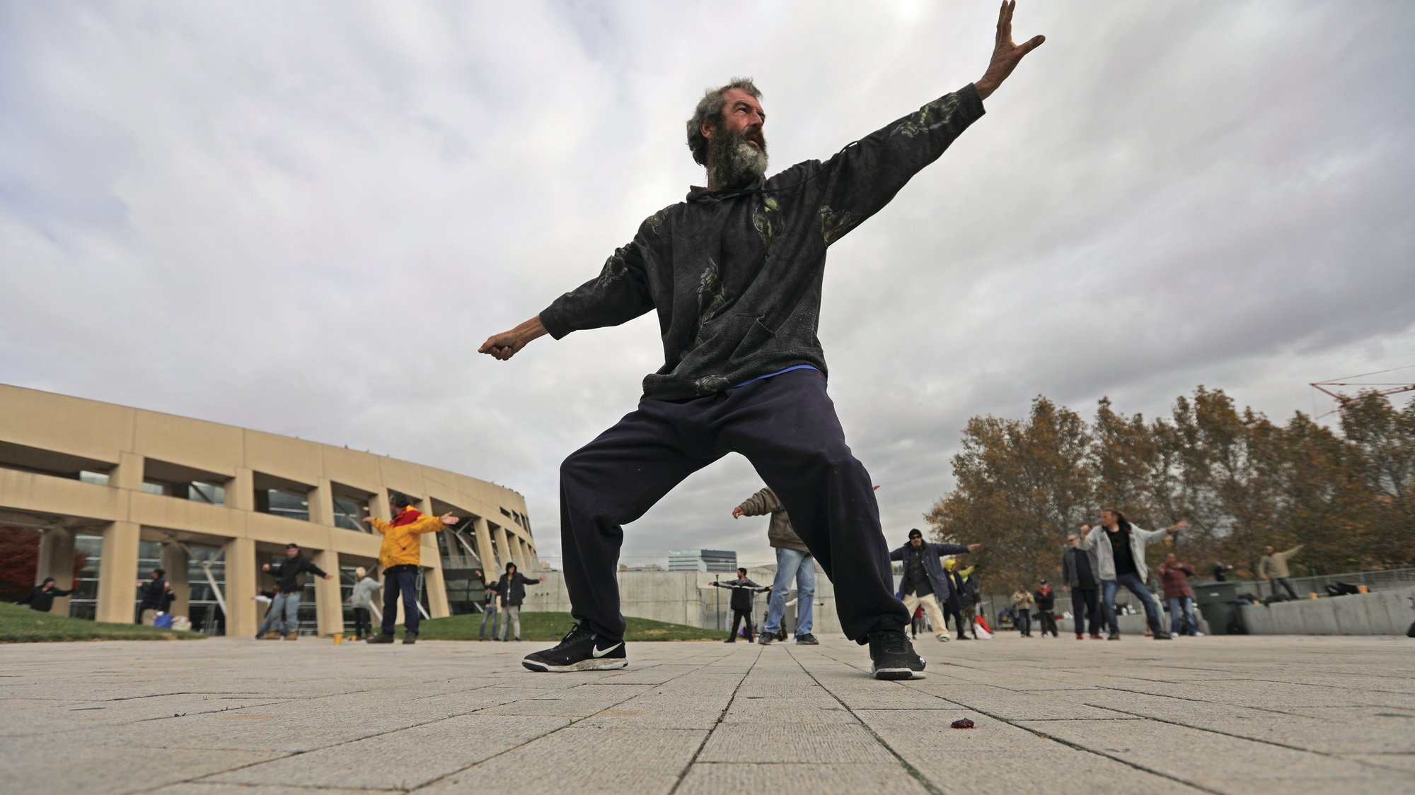 PHOTOS BY THE ASSOCIATED PRESS  David Christopher Coons performs tai chi at the Salt Lake City Main Library in Salt Lake City, Utah.  The participants are homeless people who take part in a free tai chi program run by a retired couple who started the classes three years earlier. Coons was fired from his job as an electrician about five years ago. He has been homeless since, vacillating between sleeping in shelters or on the streets.