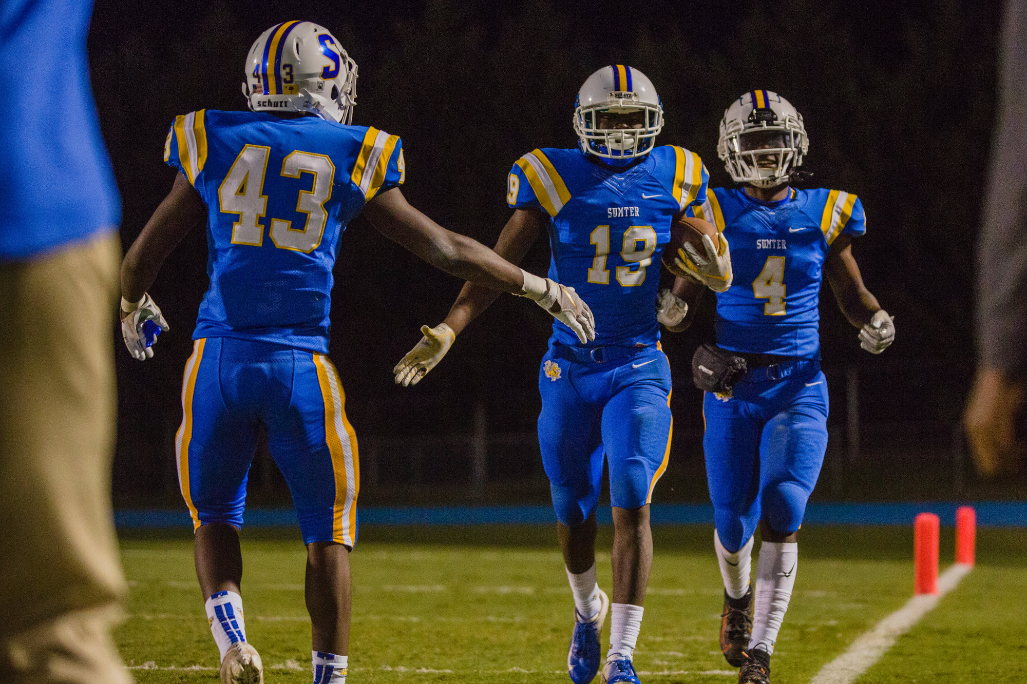 Sumter defensive back Zyeir Gamble (19) is congratulated by teammate Jabari Tiller after one of his two interceptions in the Gamecocks' 34-14 win over Irmo on Friday. Sumter plays host to Woodmont in the first round of the 5A state playoffs on Friday.